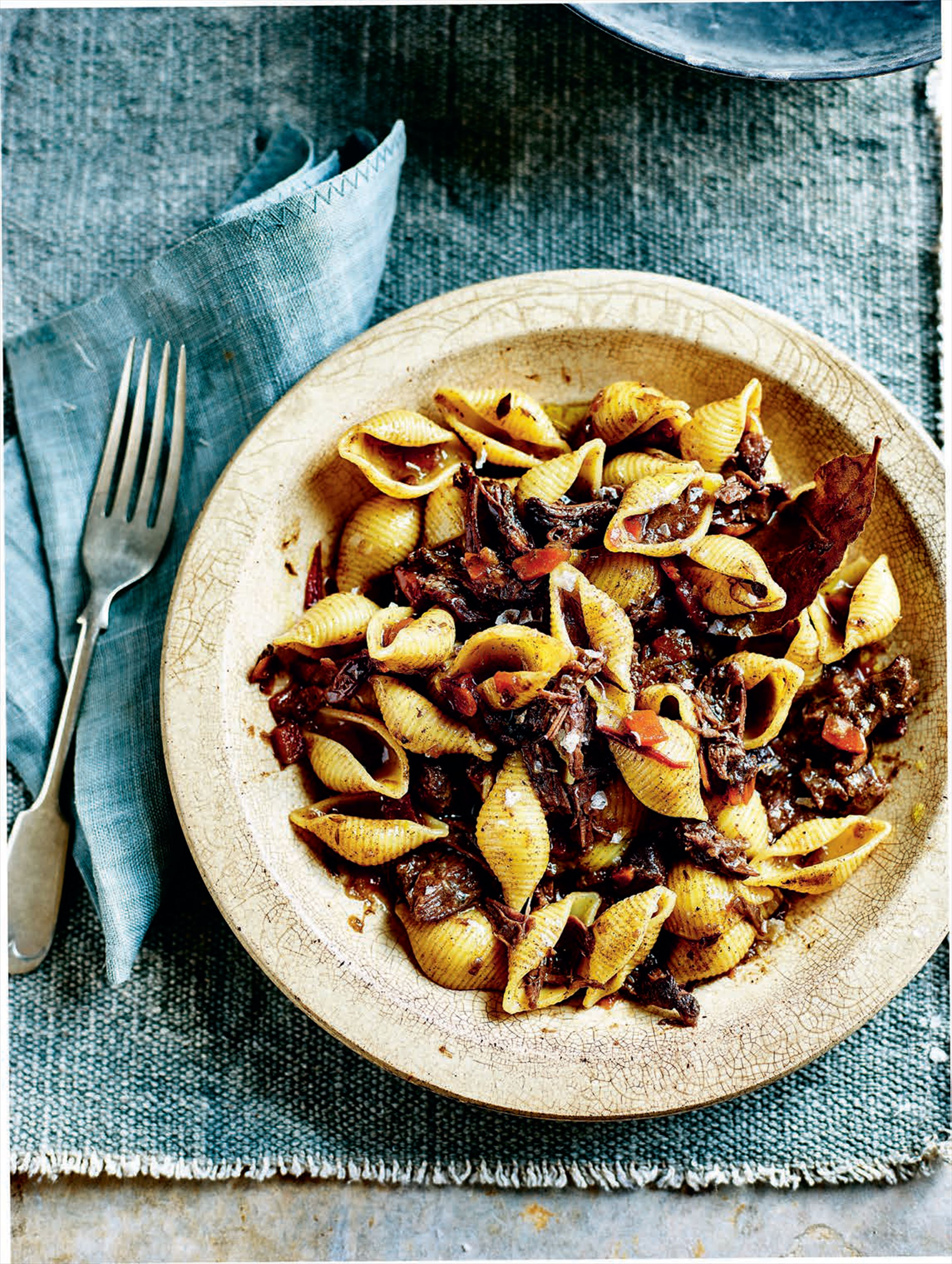Stewed pig cheeks with pasta