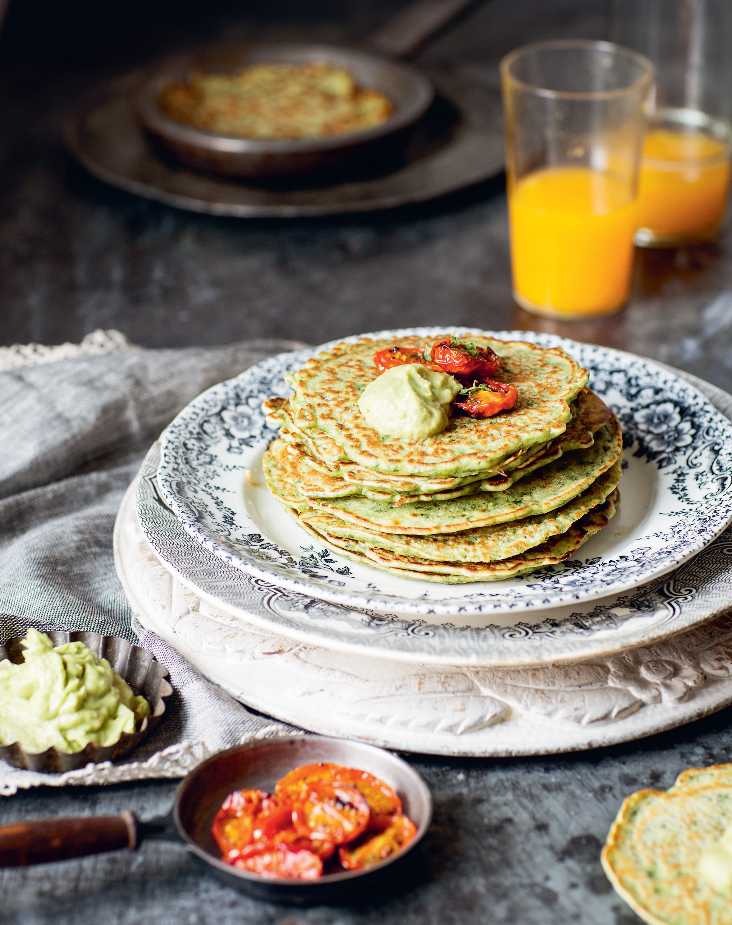 Kale + coriander pancakes with slow-roasted tomatoes + avocado cream