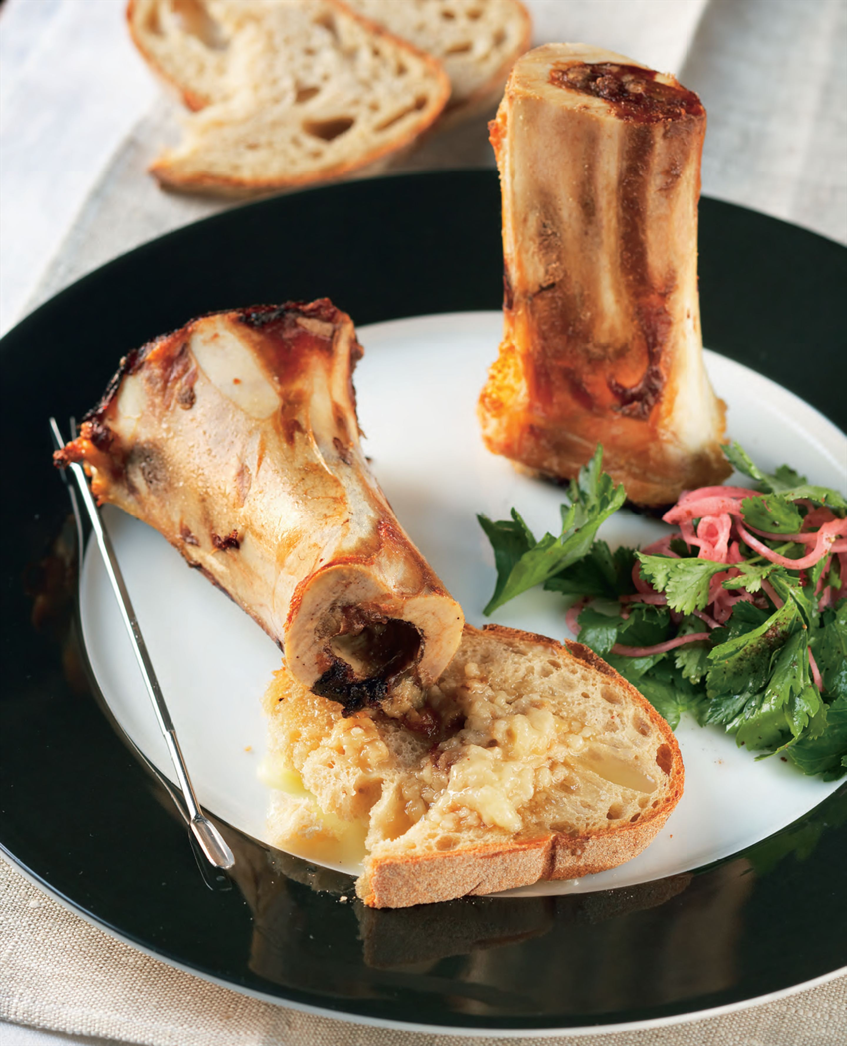Roasted bone marrow with red onion salad
