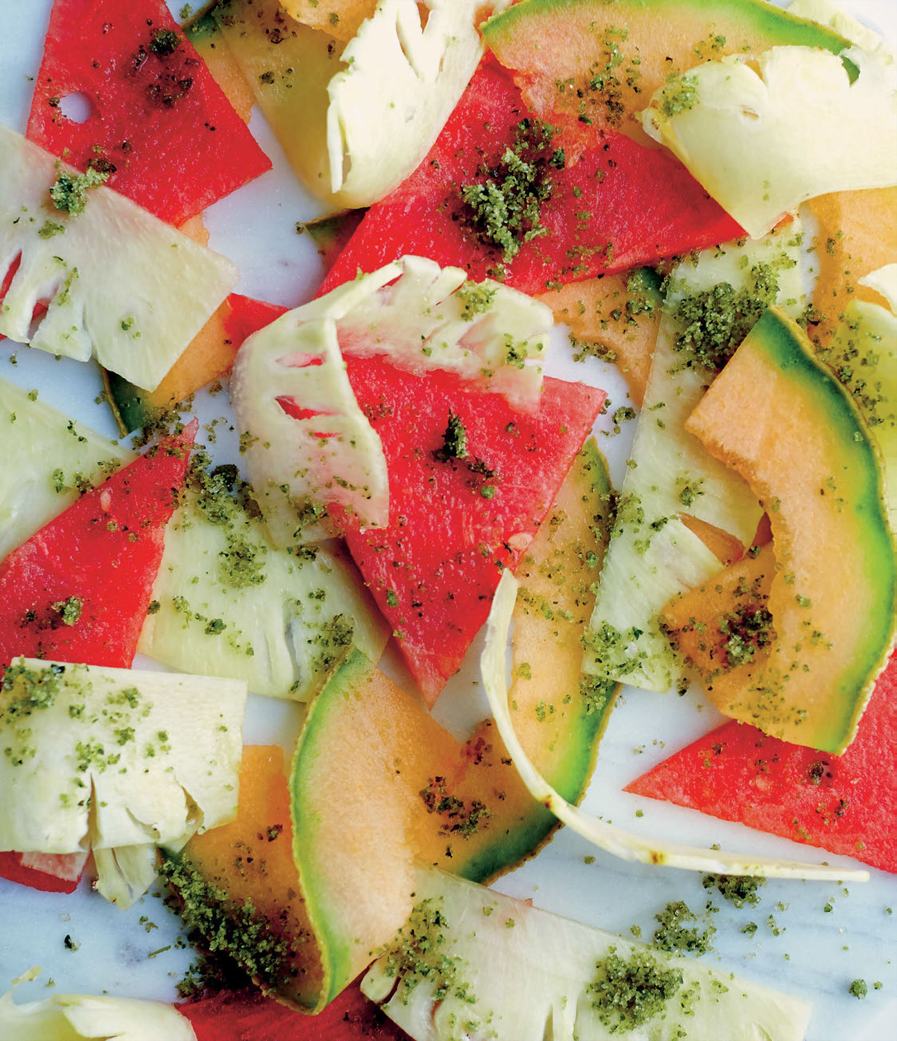Pineapple and melon carpaccio with mojito sugar