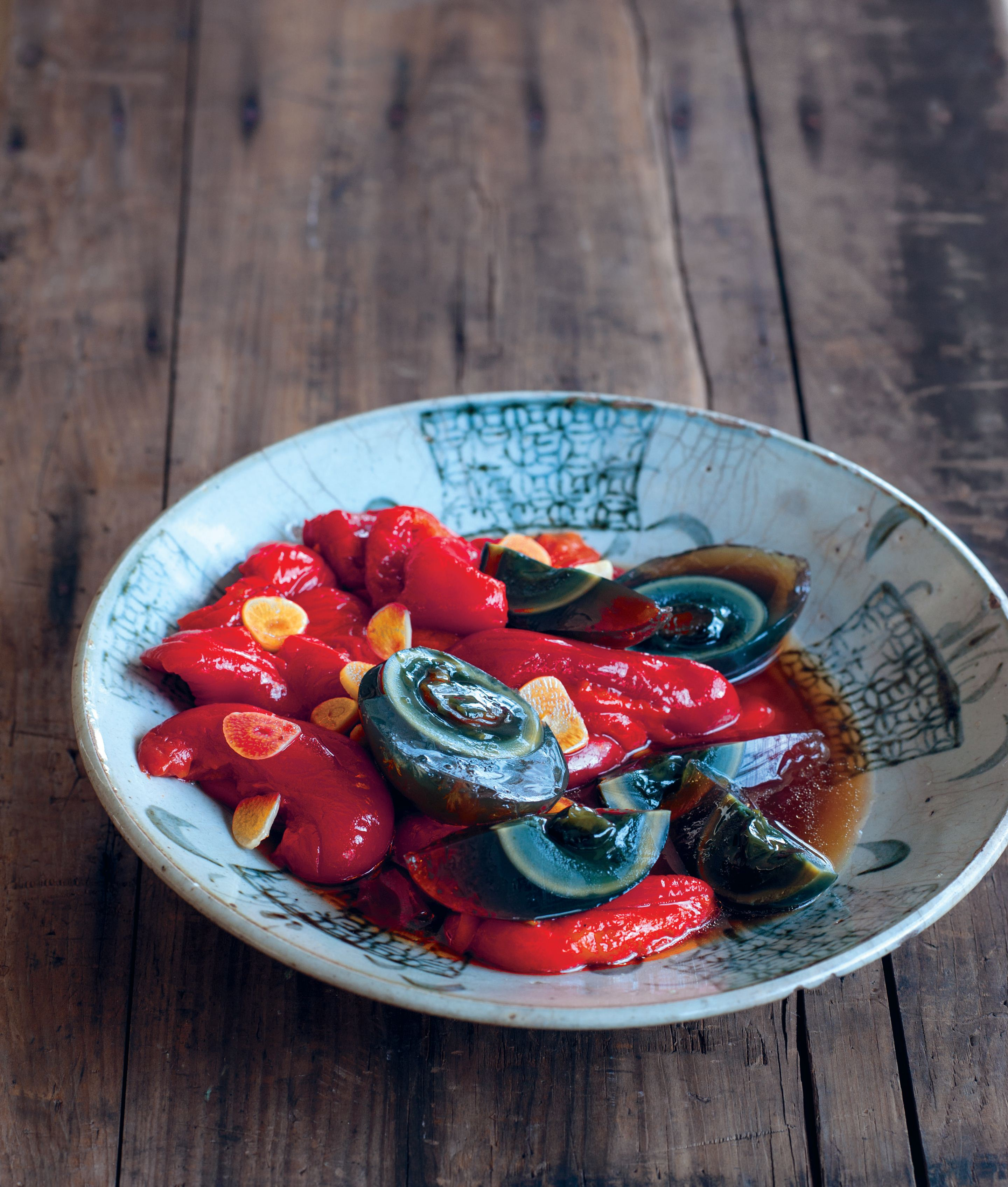 Braised red capsicums with century eggs