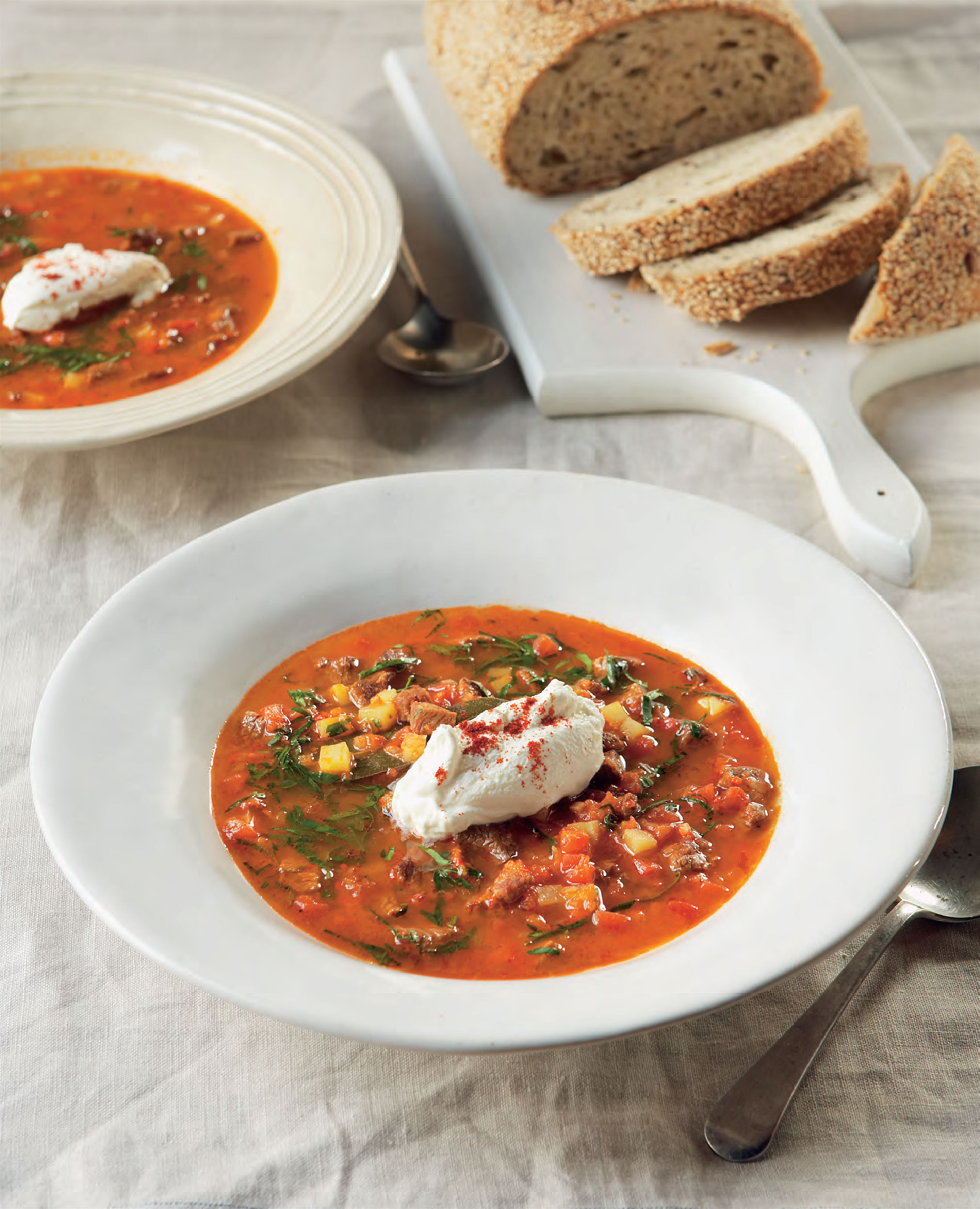 Hungarian goulash soup with sour cream and chives