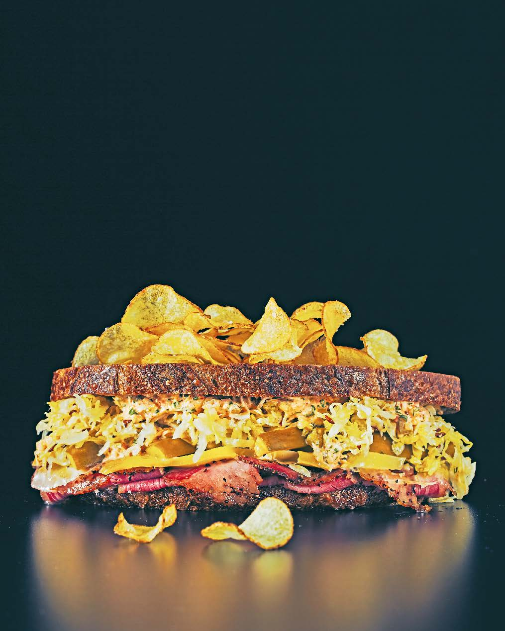 Toasted Reuben: emmental, pastrami, sauerkraut, thousand island dressing, dill pickles + potato chips.