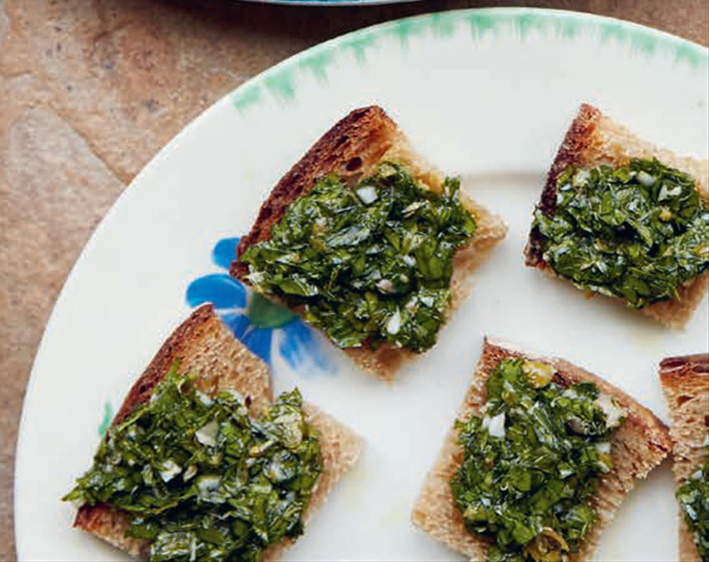 Toasted bread with green sauce
