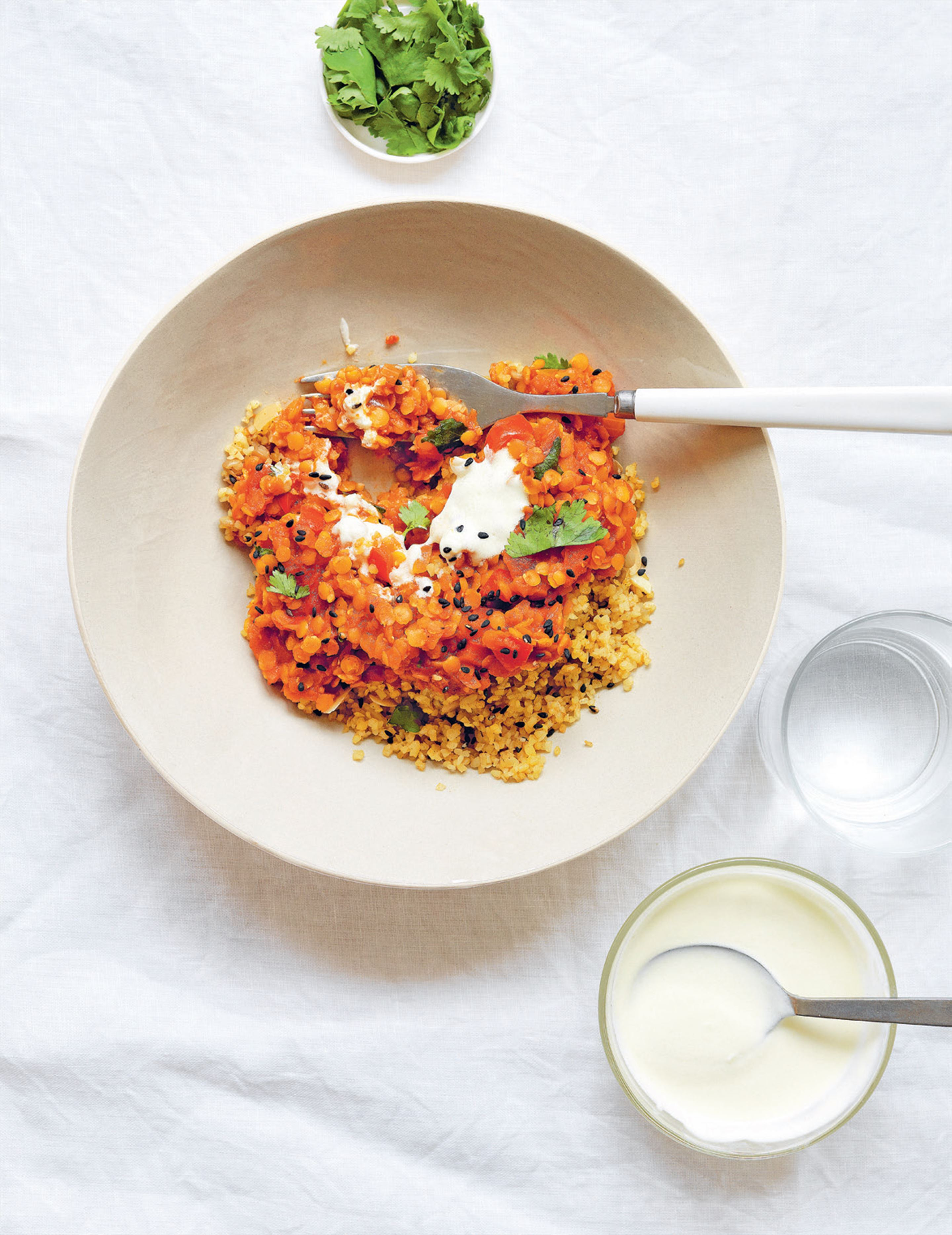 Spiced red lentils with yoghurt, coriander & sesame seeds