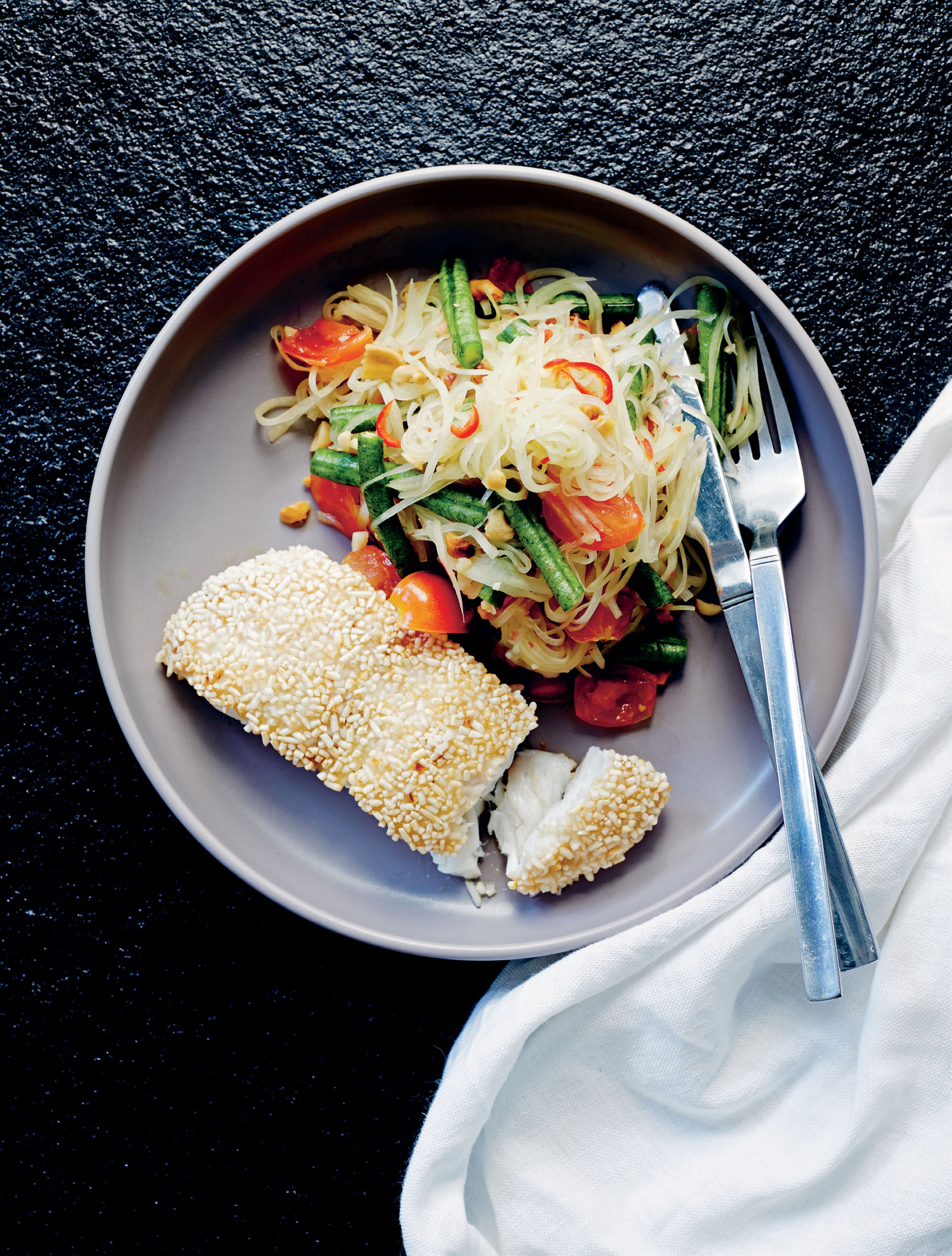 Rice-crusted snapper with green papaya, chilli & peanut salad