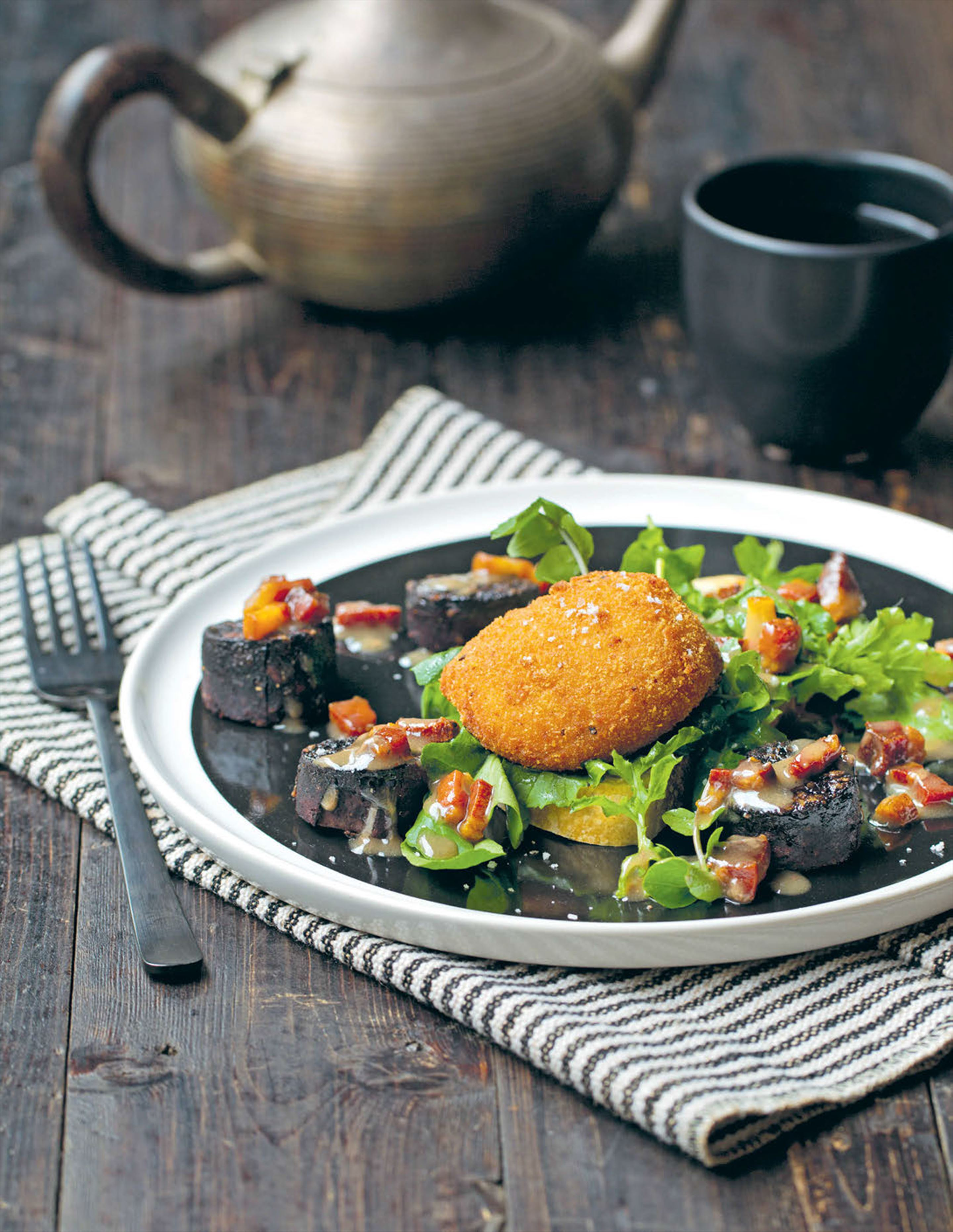 Crumbed coddled eggs with black pudding salad