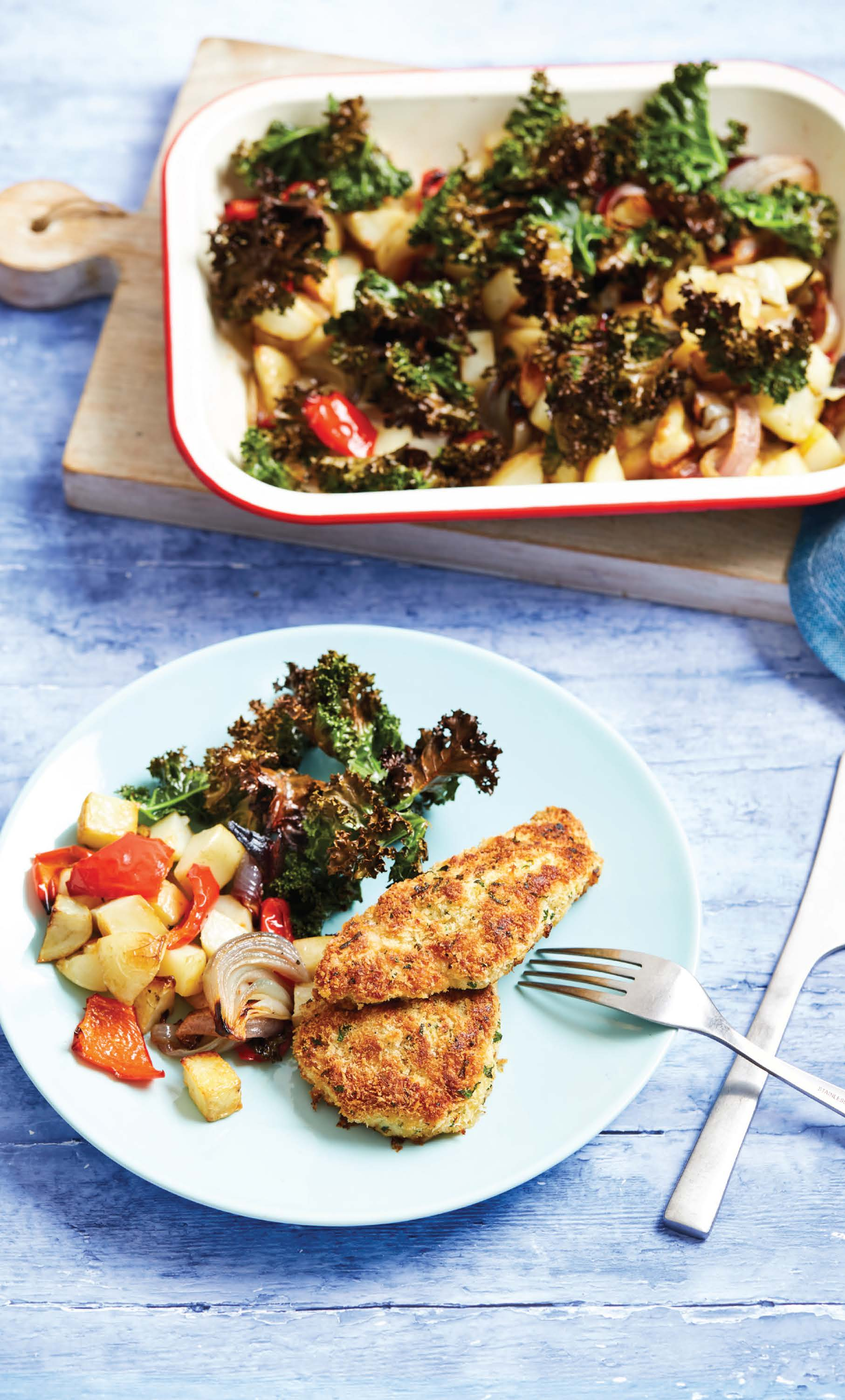 Crumbed chicken with roasted vegetables and crispy kale