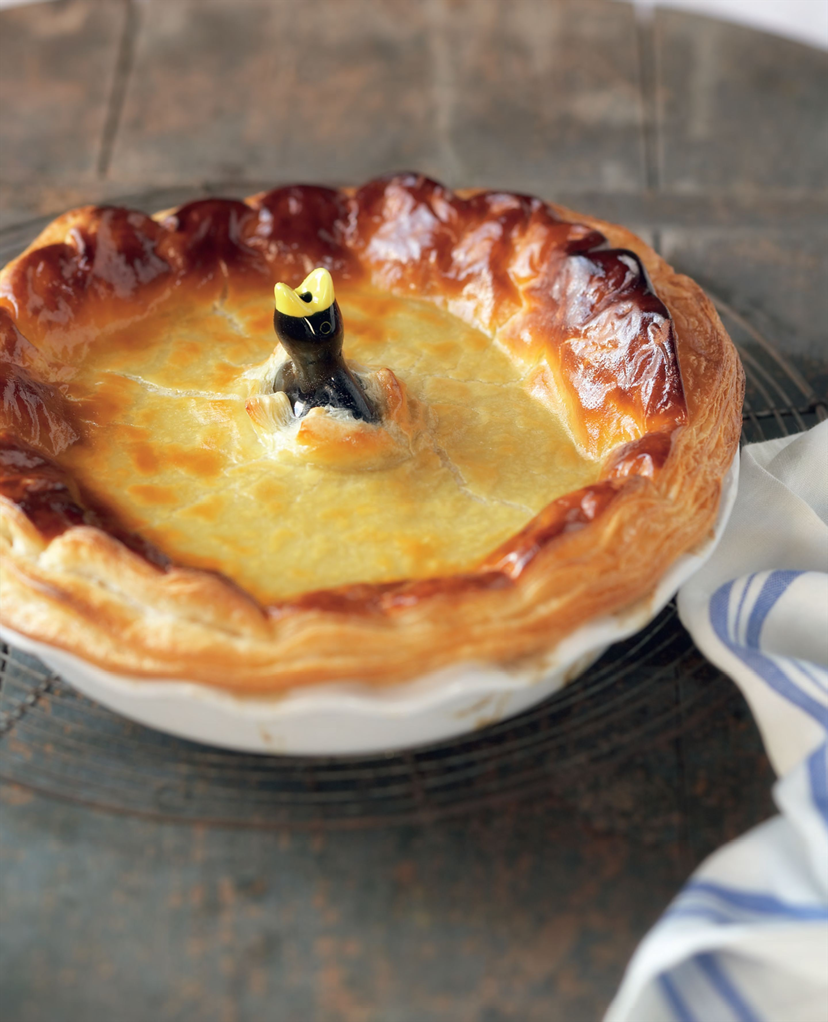 Family-size chicken, leek and mushroom pie