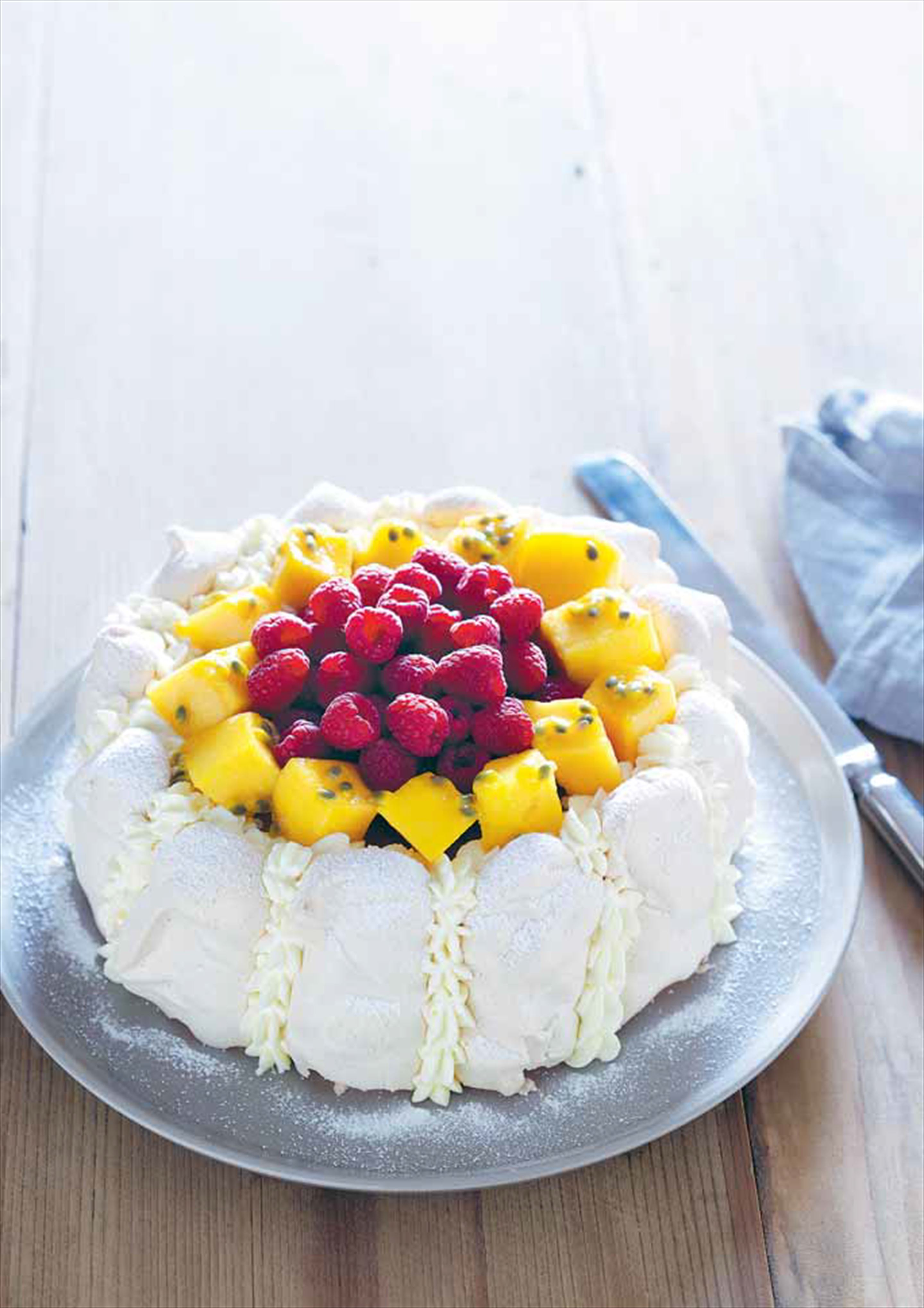 Strawberry vacherin with mango and raspberries