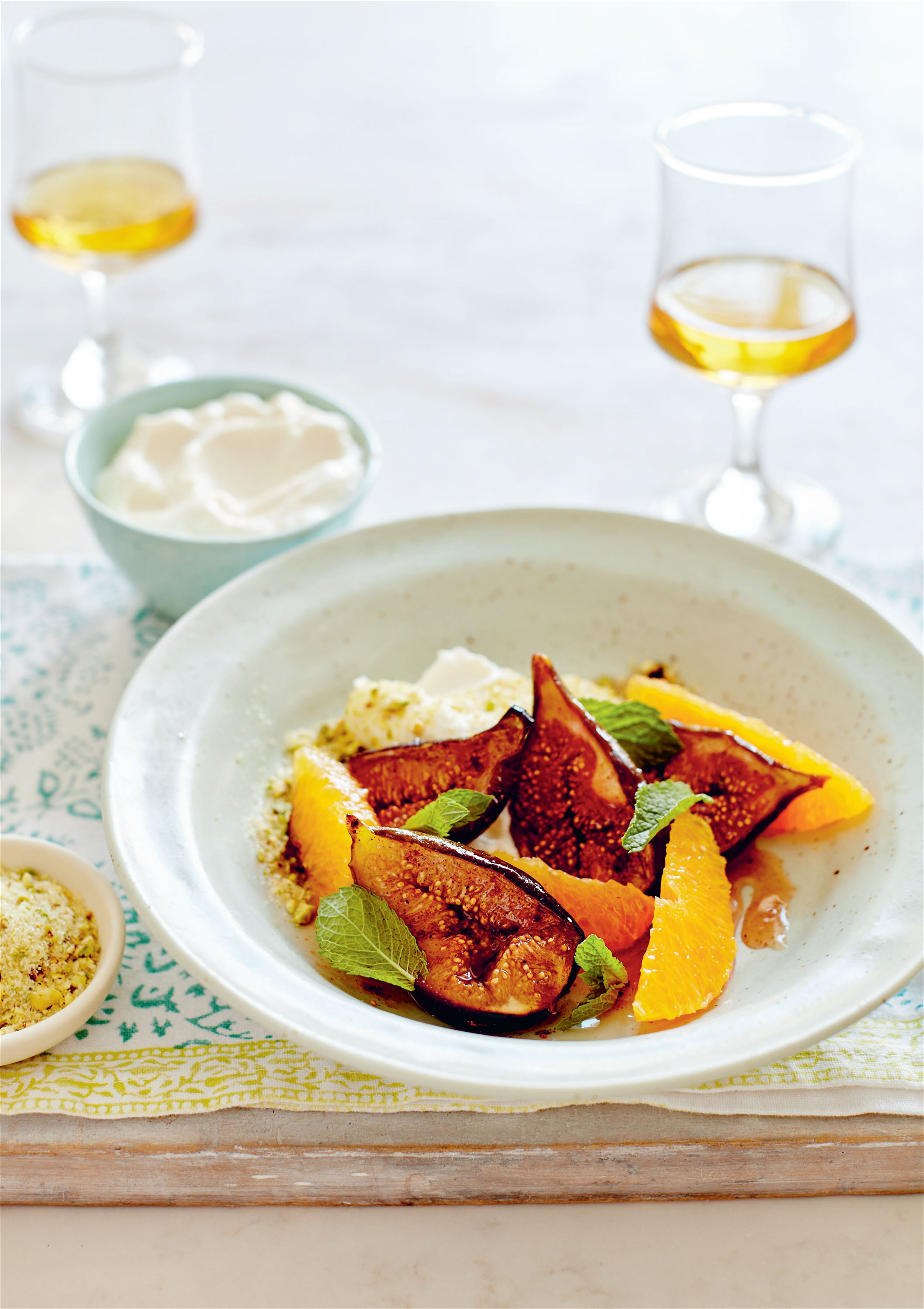 Orange and fig salad with orange blossom ricotta and pistachio praline