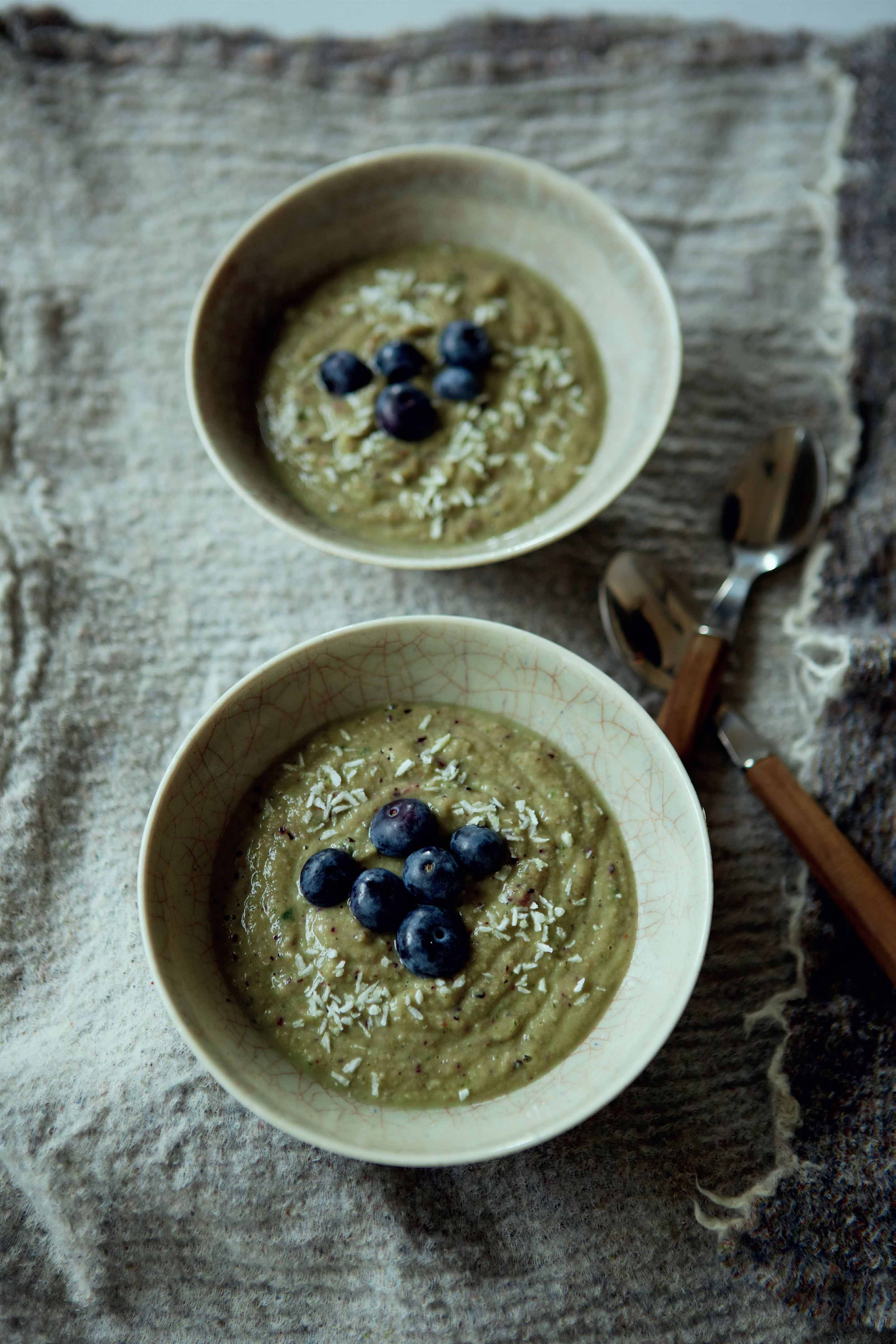 Creamy breakfast Bowl with basil and blueberries