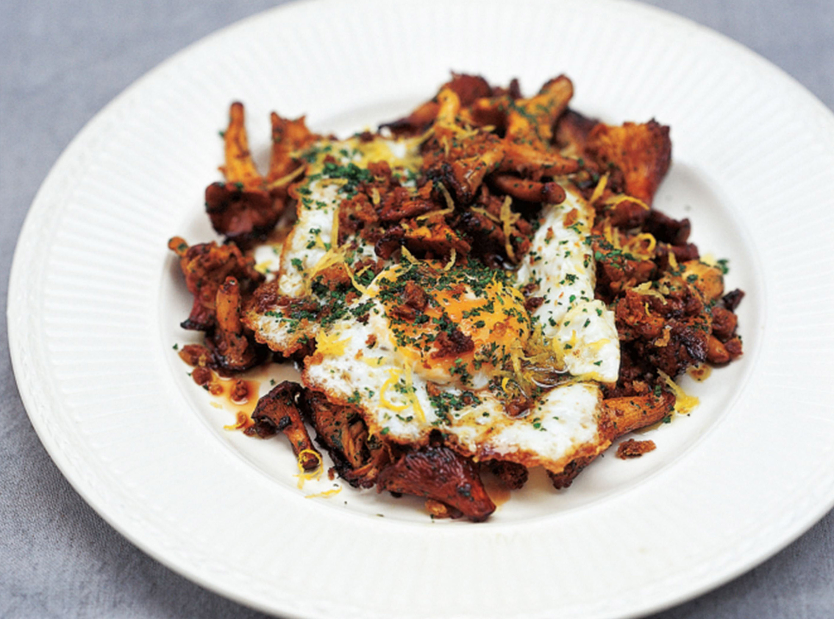 Girolles with fried egg and sourdough breadcrumbs