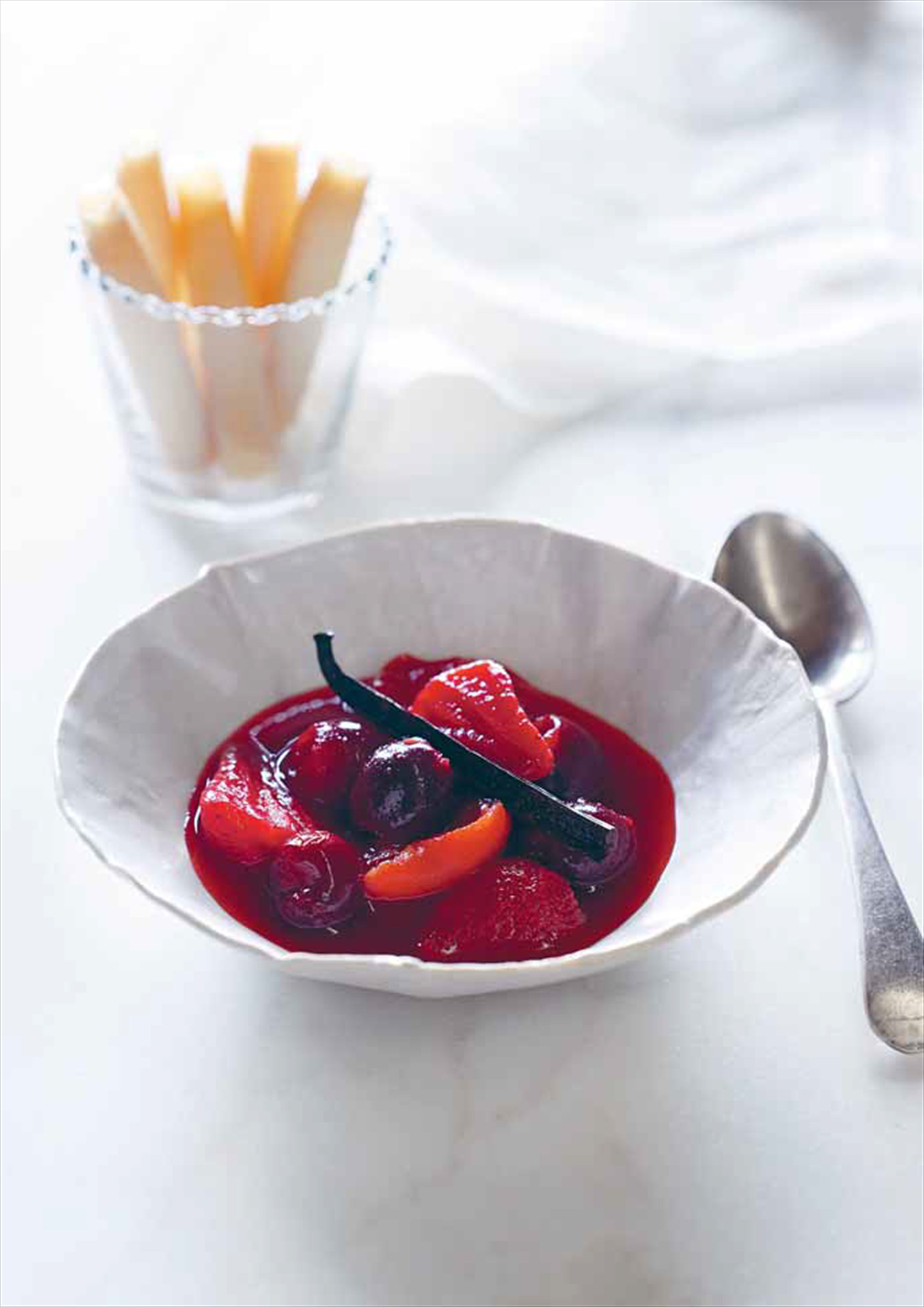 Stewed cherries with strawberries and apricots