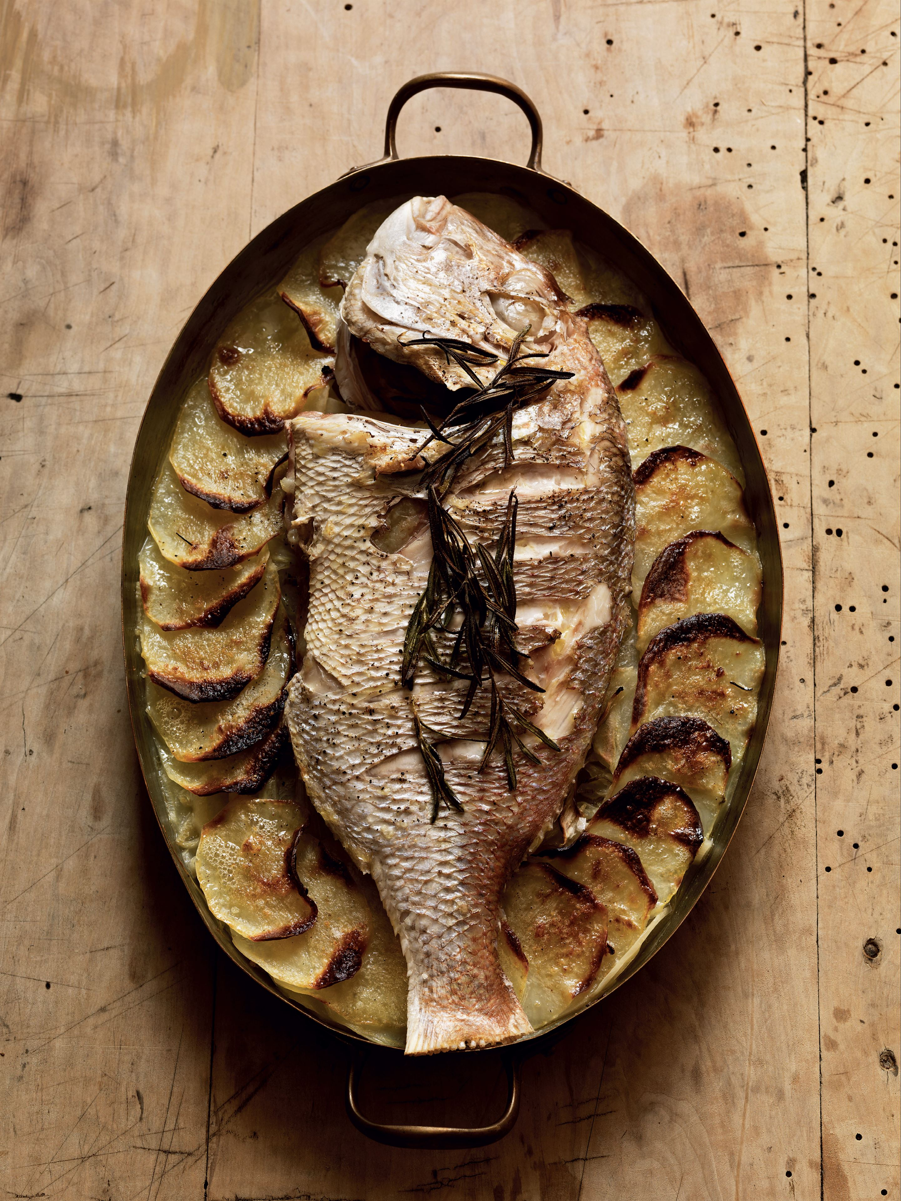 Fish with baker's potatoes