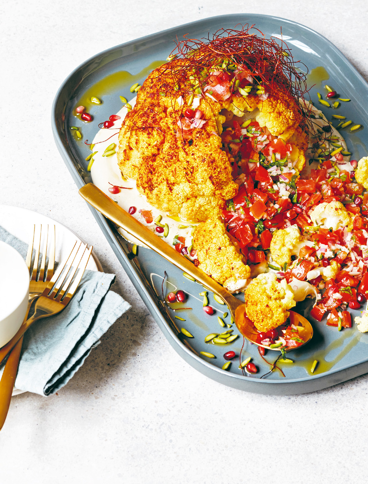 Whole roasted cauliflower with tahini and tomato salsa