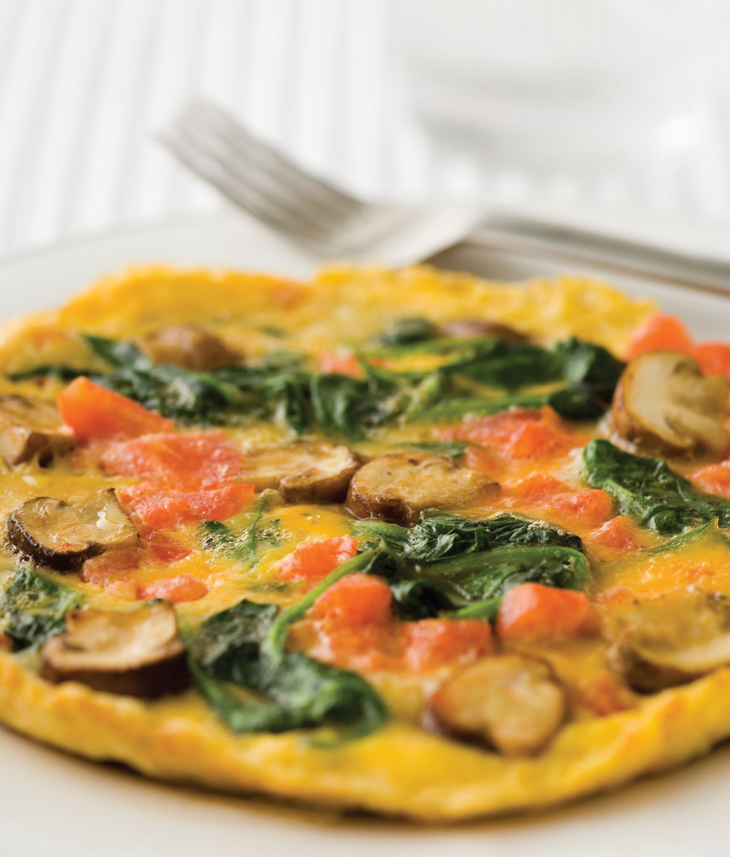 Breakfast omelette with mushrooms and spinach