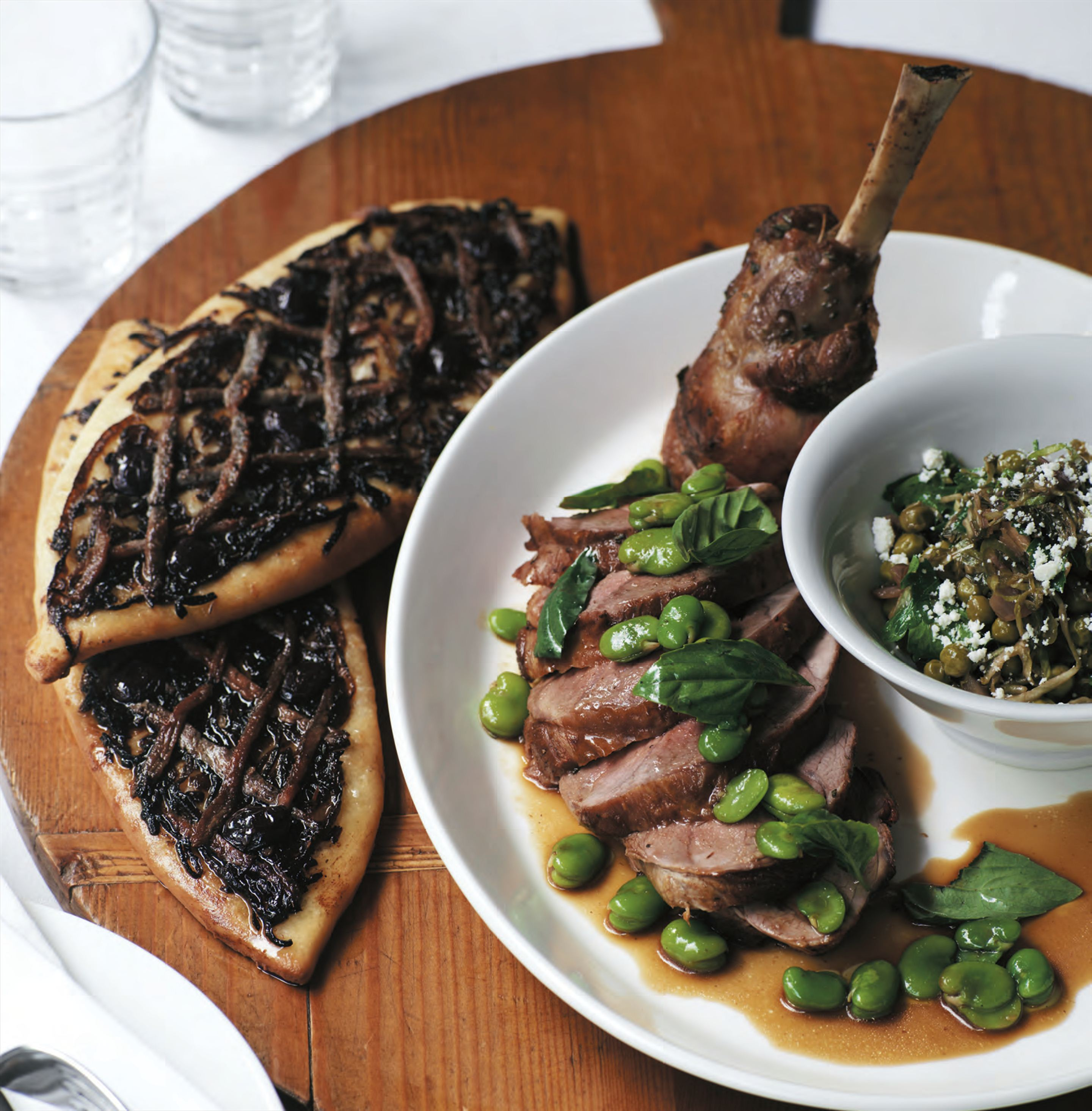 Roasted milk-fed leg of lamb with pissaladière tart