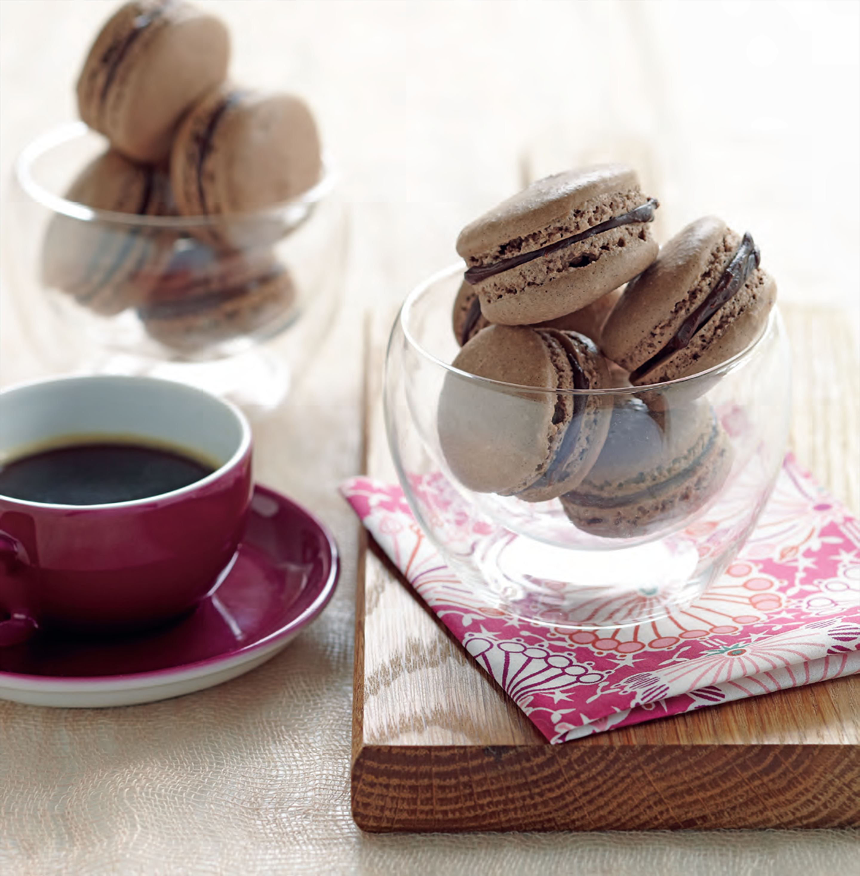Chocolate macarons with espresso and cocoa nibs
