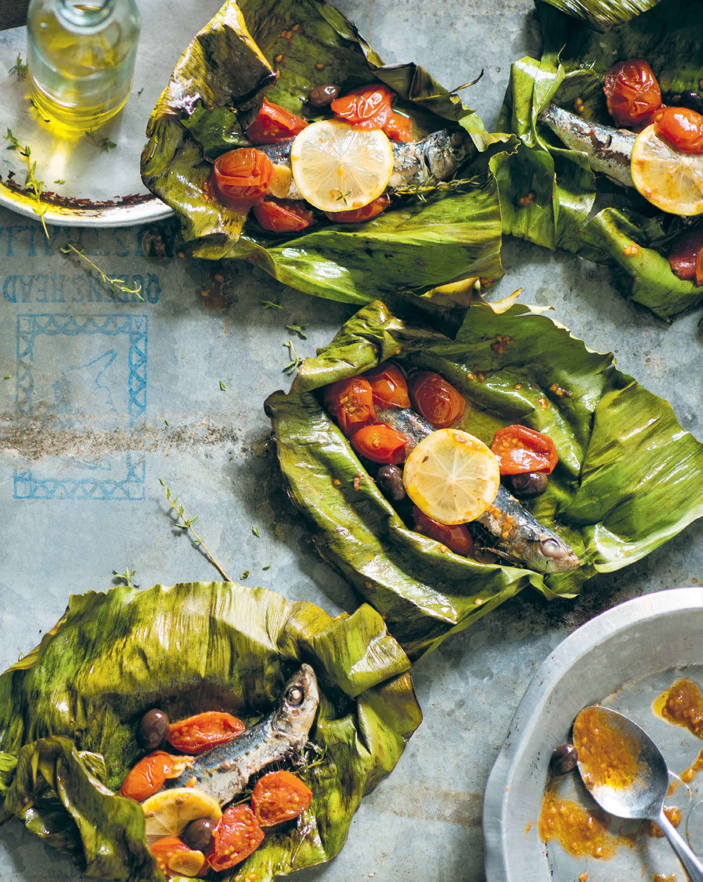Sardines roasted in banana leaves with olives & cherry tomatoes