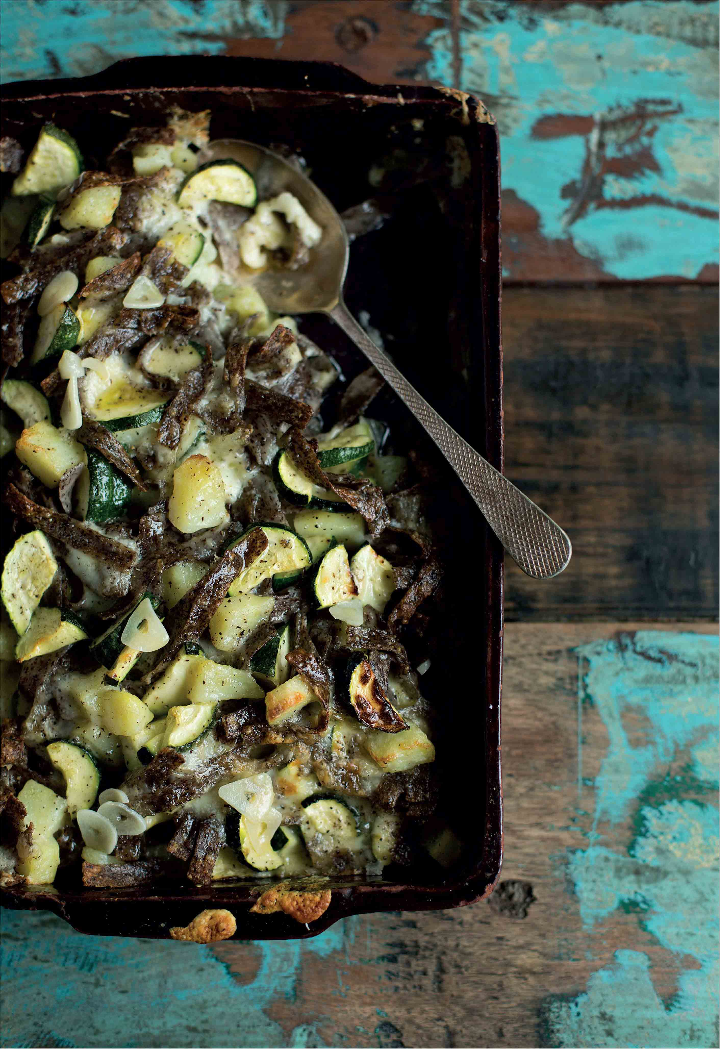 Baked buckwheat noodles with cheese, courgettes and potato