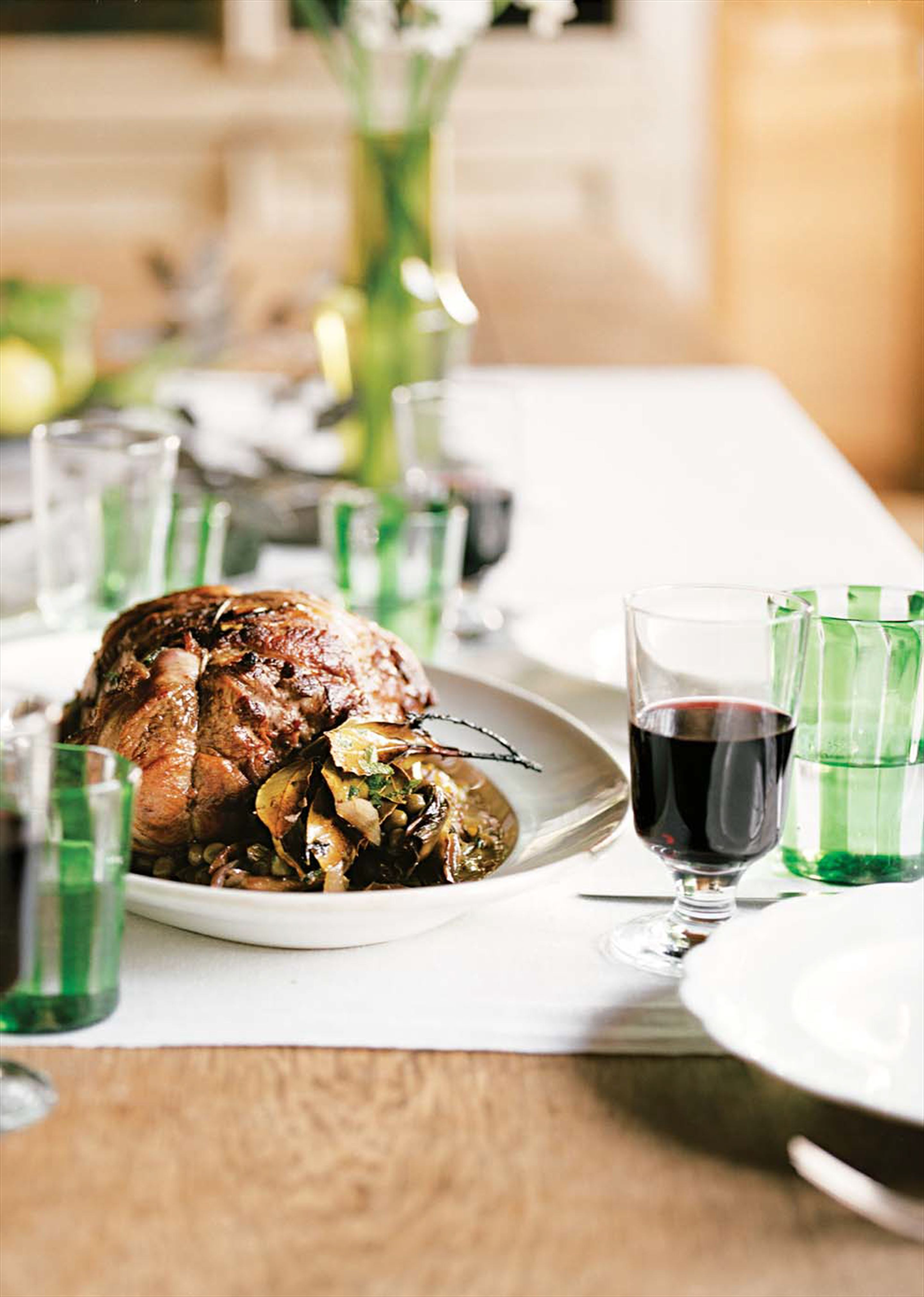 Slow-cooked lamb with artichokes, peas and mint