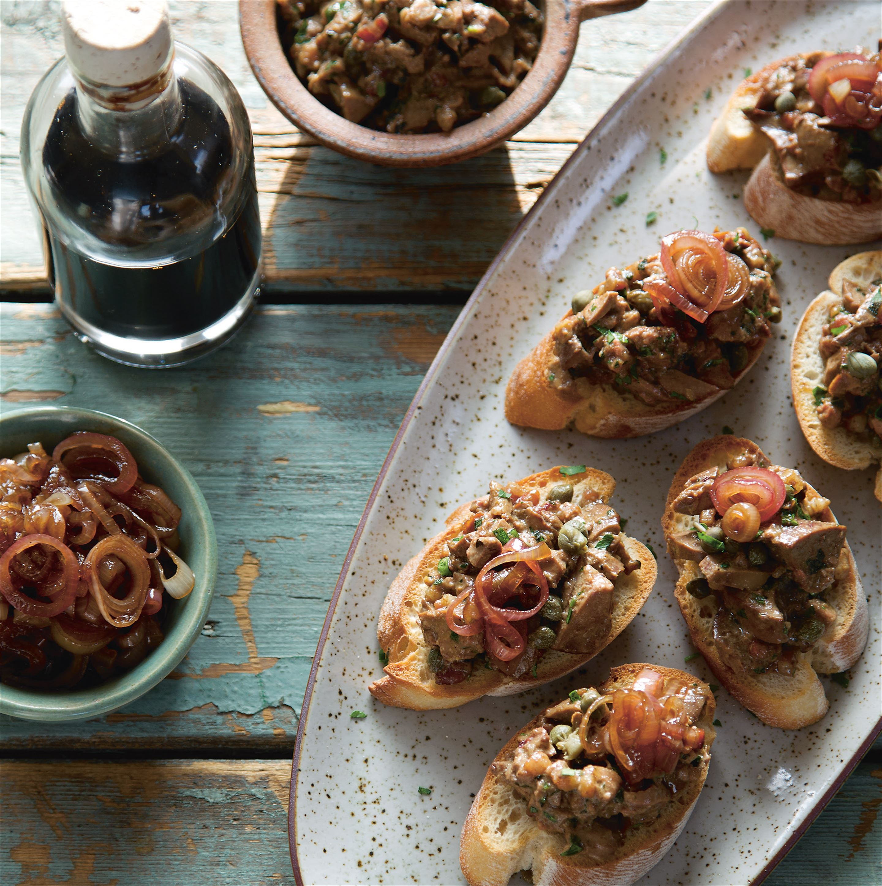 Chopped chicken liver crostini with balsamic shallots