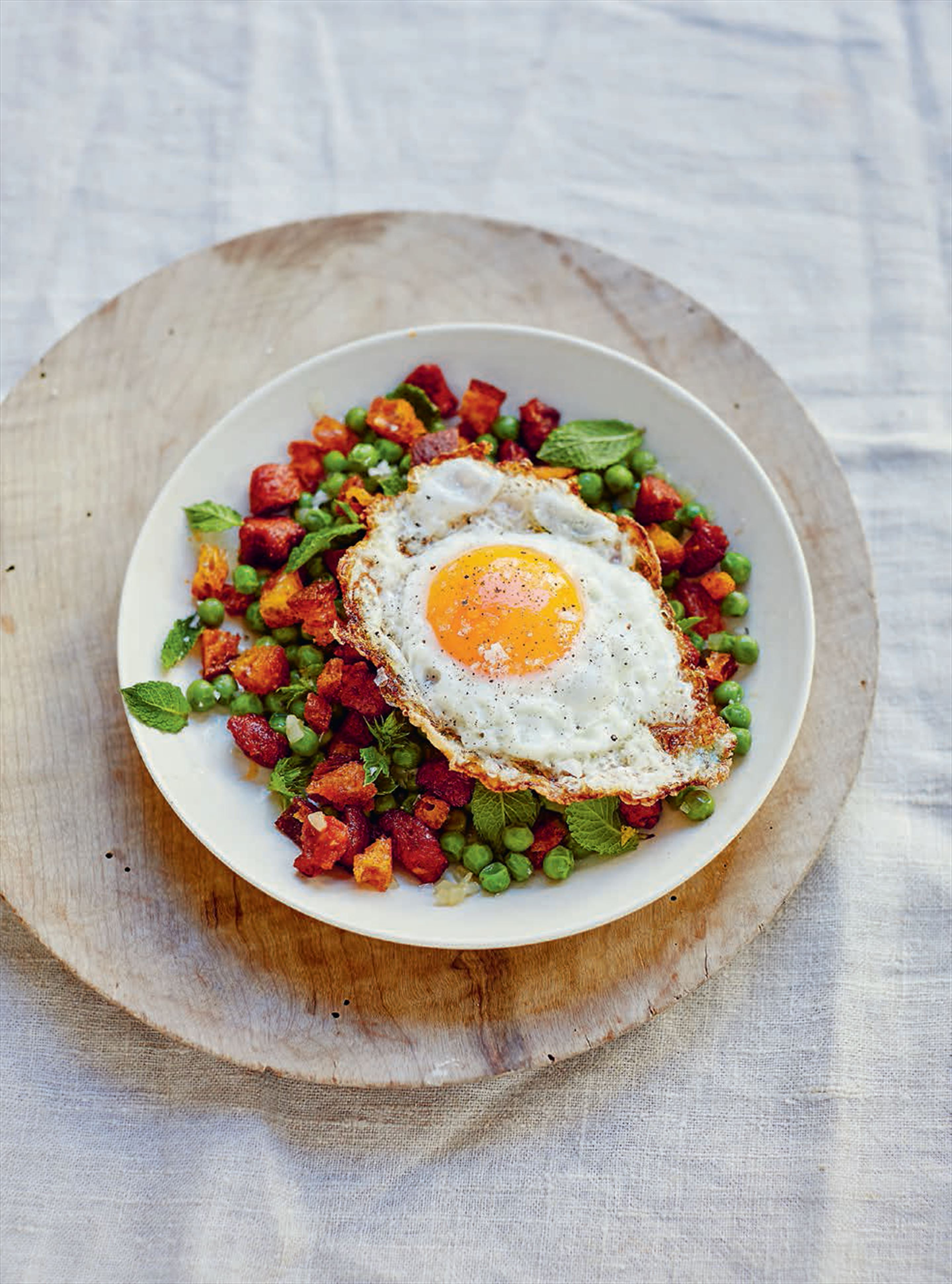 Sautéed peas with chorizo migas & golden fried egg