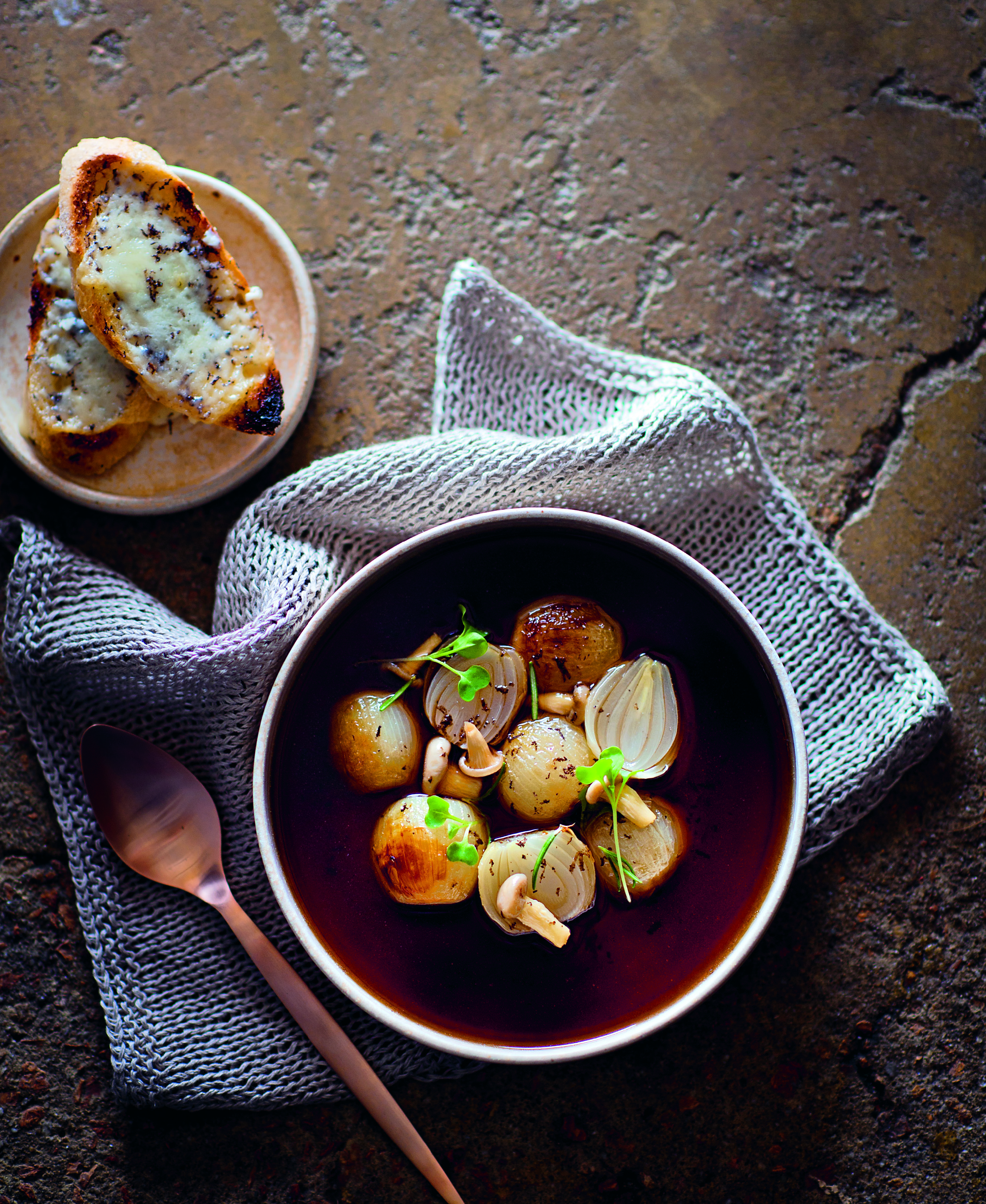 Mushroom consommé with slow-roasted baby onions and truffle toasts