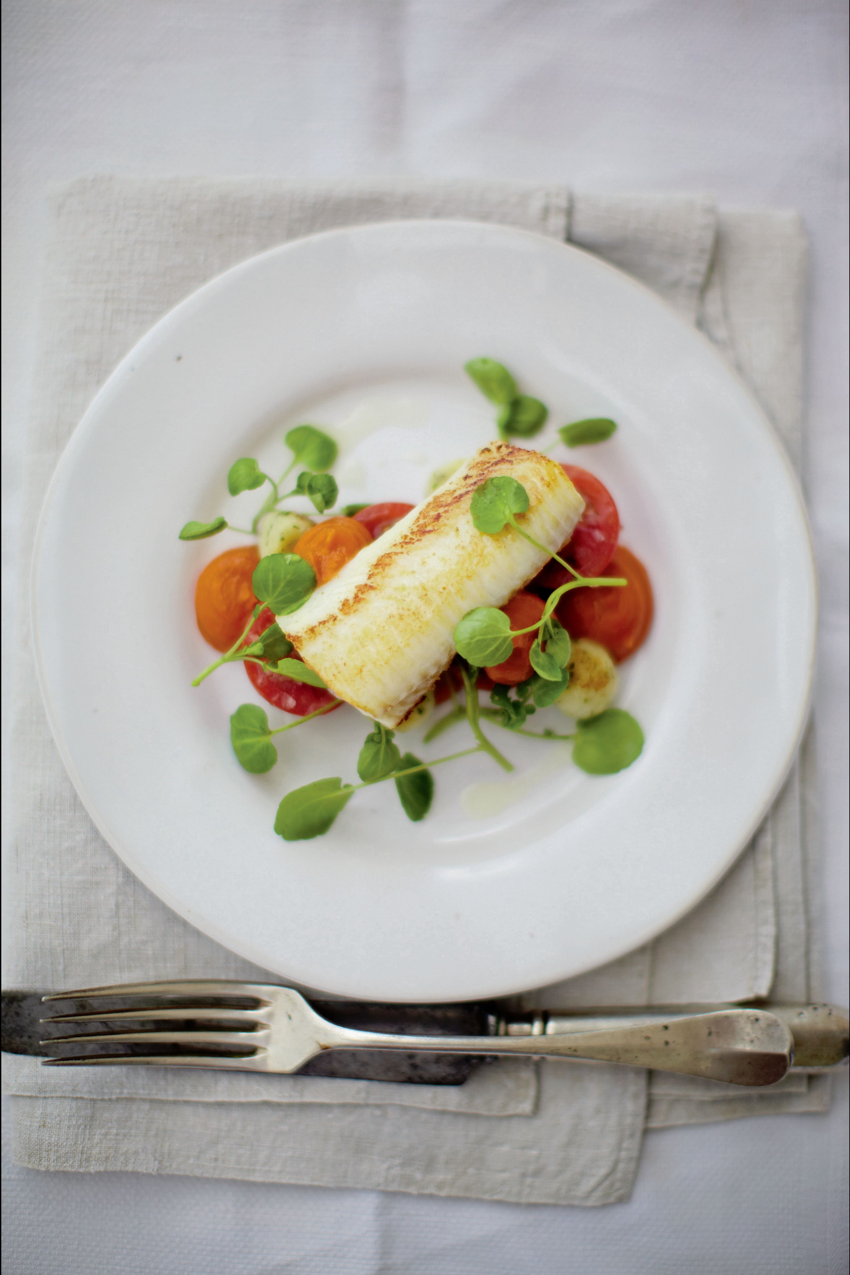 Rosemary cured haddock with tomatoes, watercress and ketchup