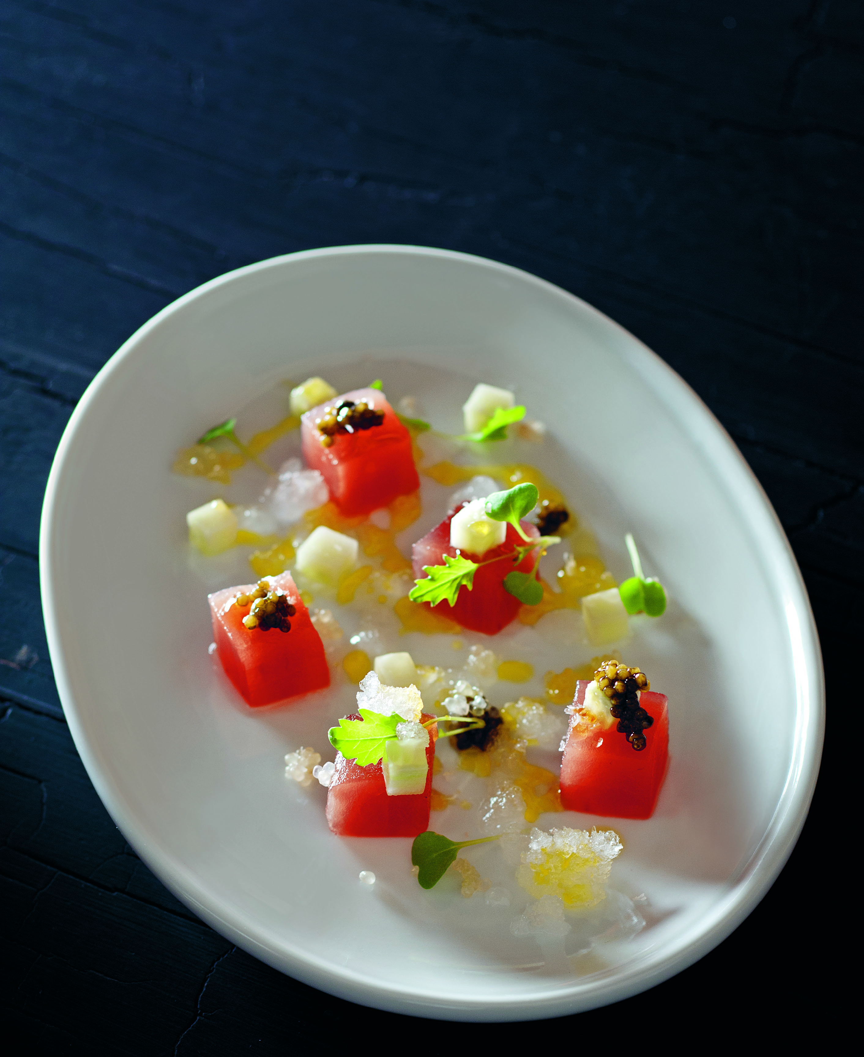 Crudo of tuna with frozen white balsamic, cucumber, finger lime and caviar