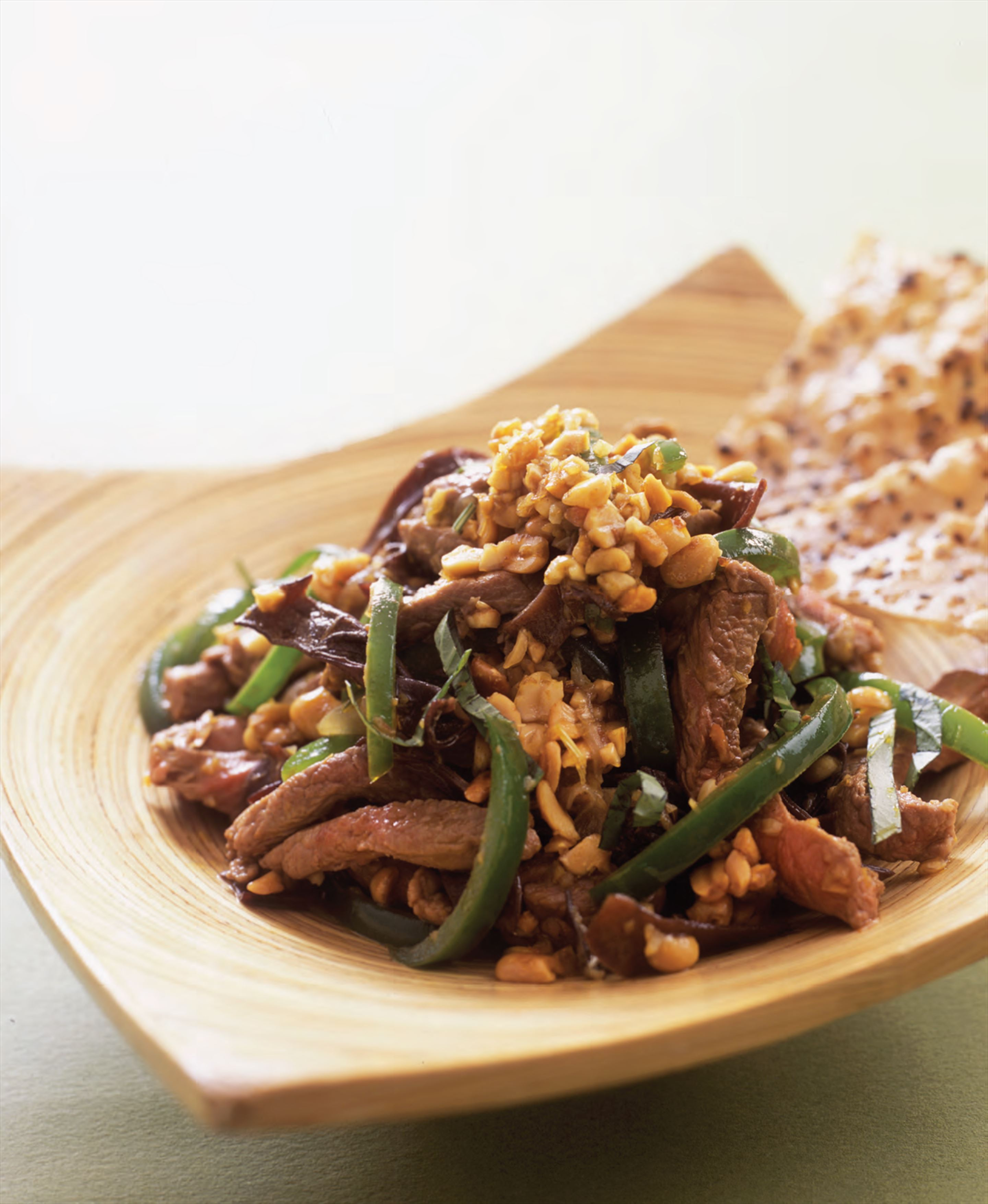 Stir-fried venison with peanuts and lemongrass