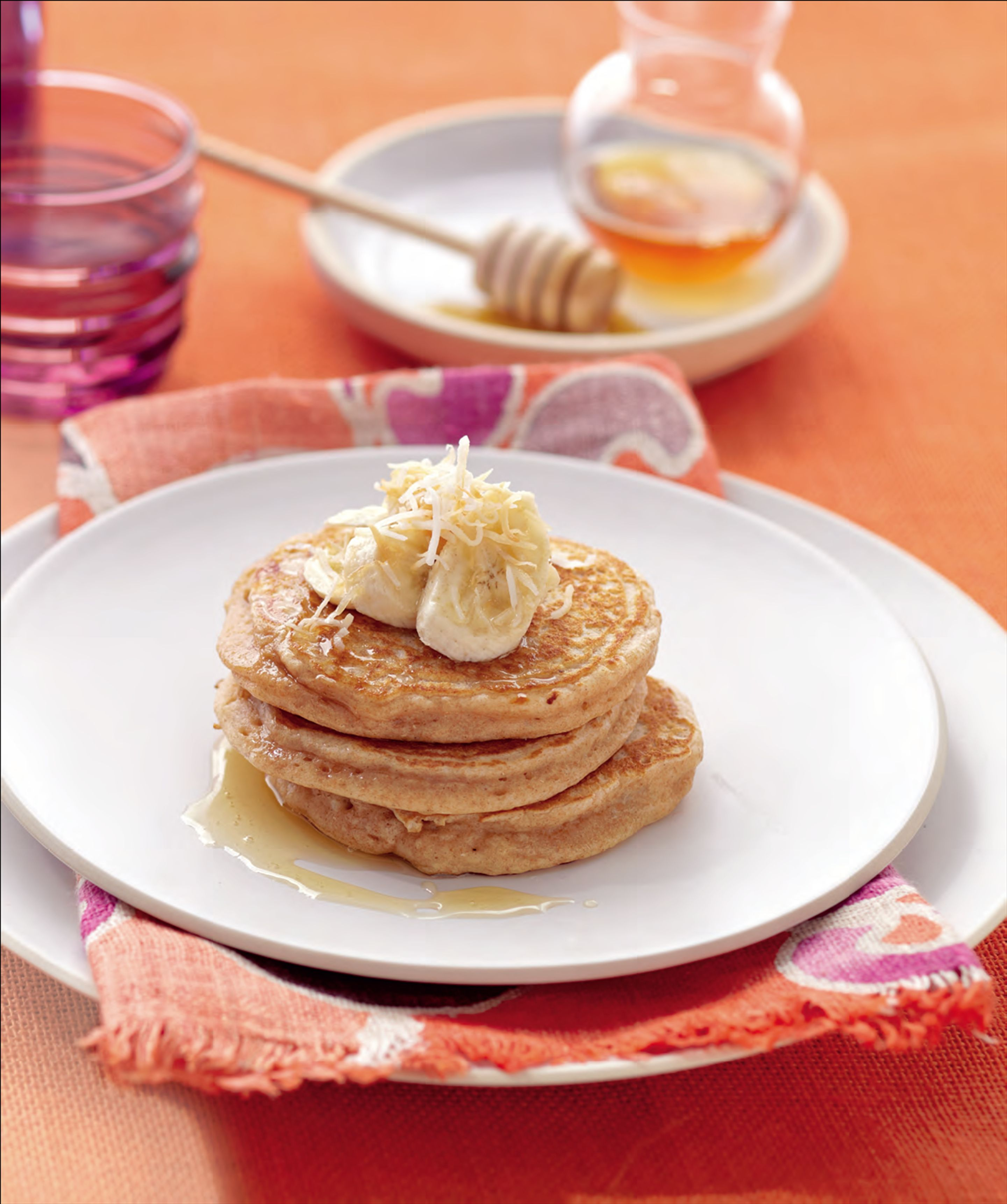 Spelt pancakes with ricotta, honey and toasted coconut