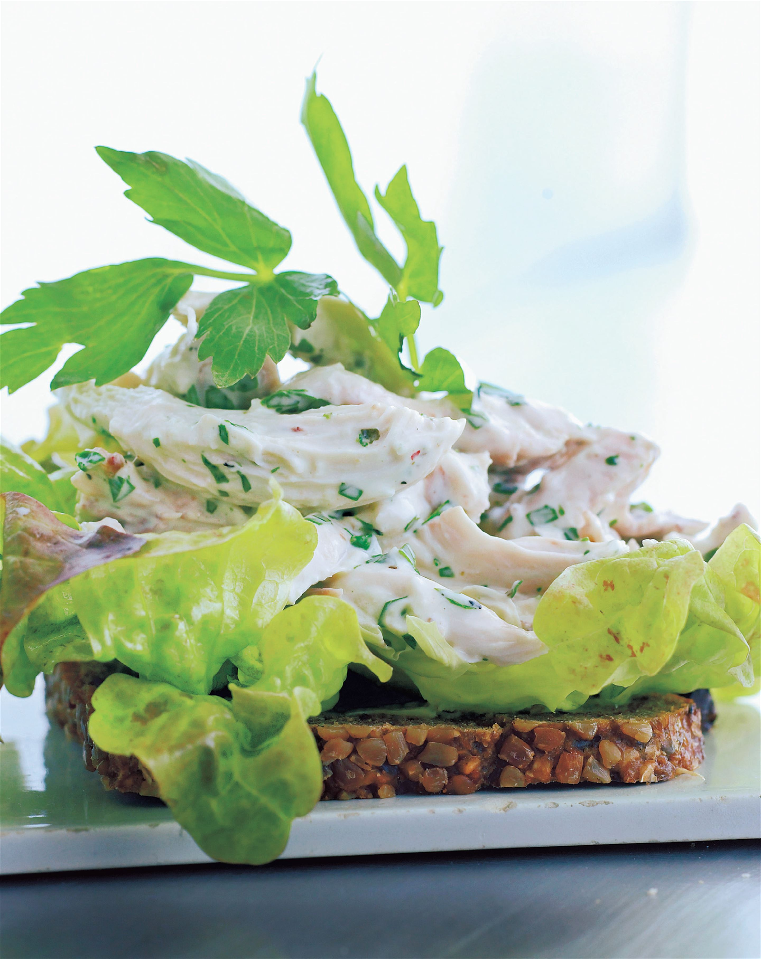 Smørrebrød: chicken and lovage salad on rye bread