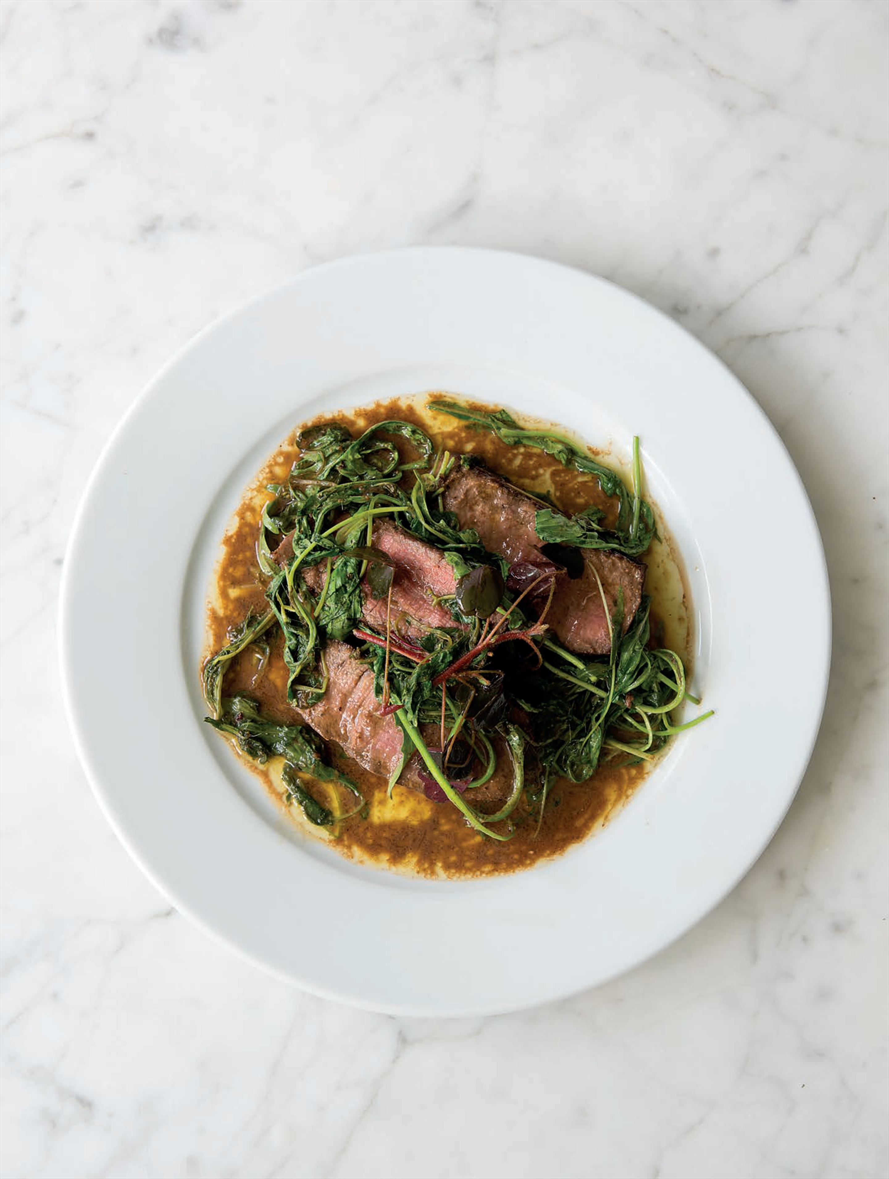 Fillet of beef with anchovy, brown butter and wild greens