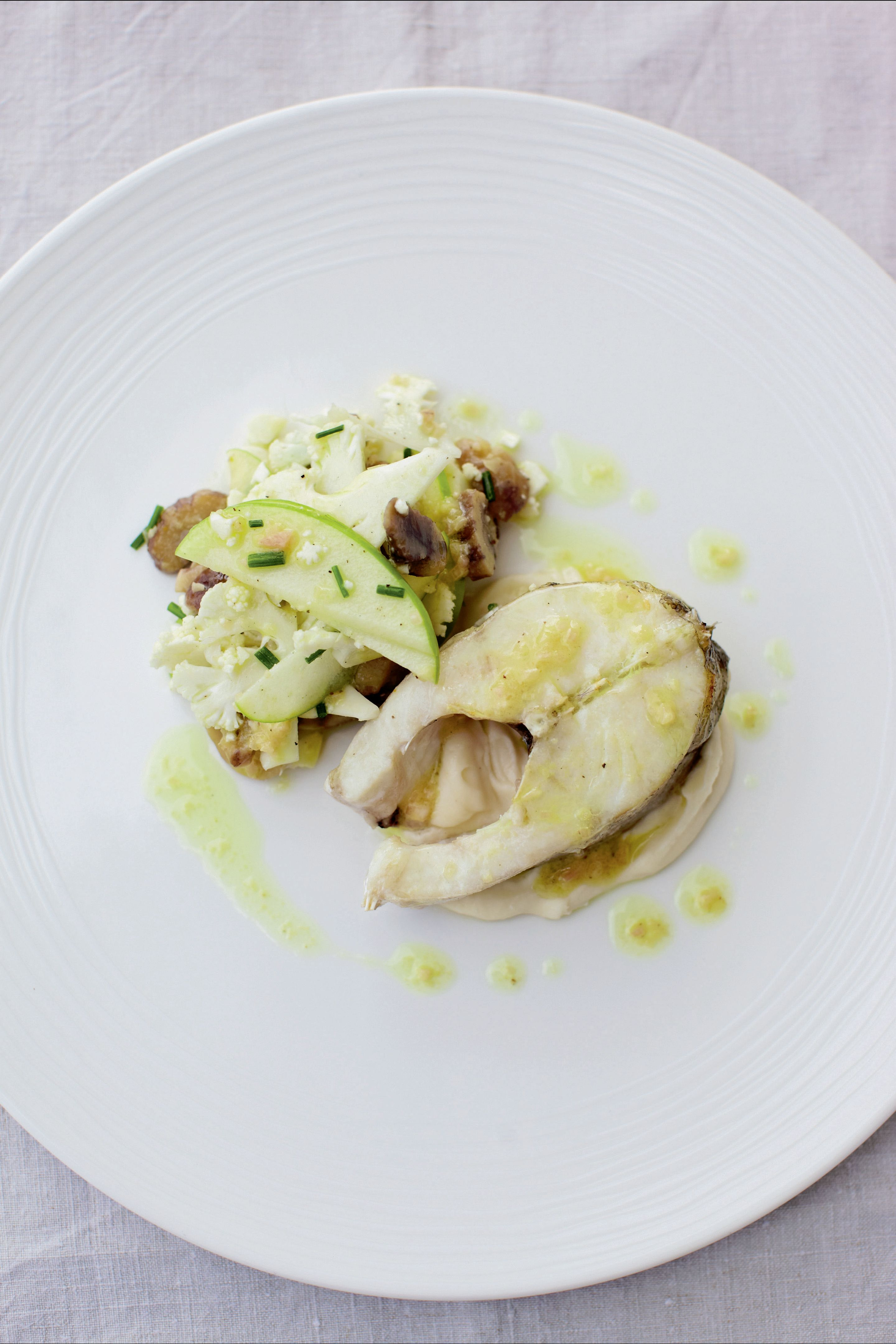 Grilled haddock with a salad of cauliflower, apples and chestnuts