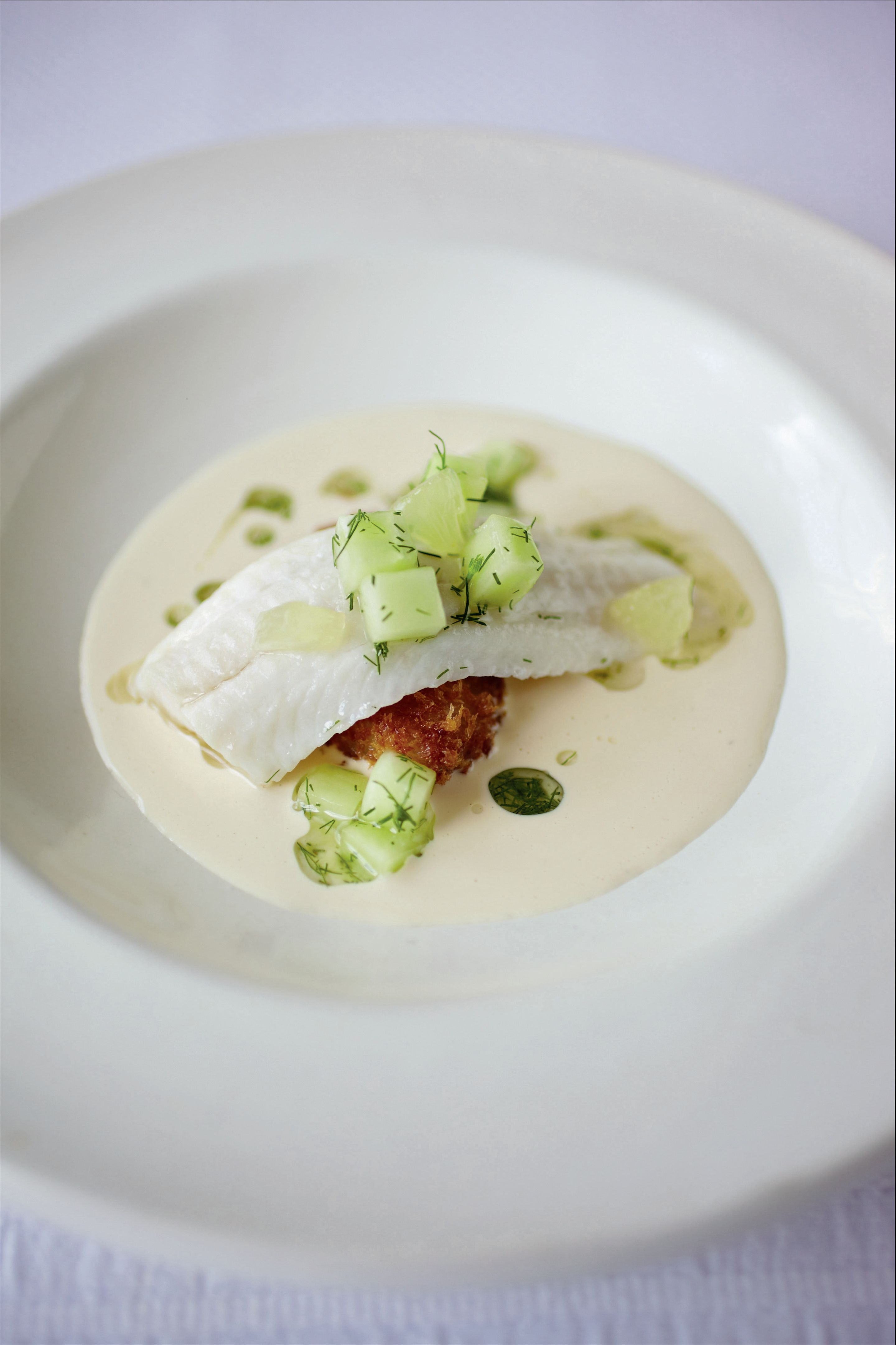 Grilled lemon sole with crispy oysters, cucumber, horseradish and lemon