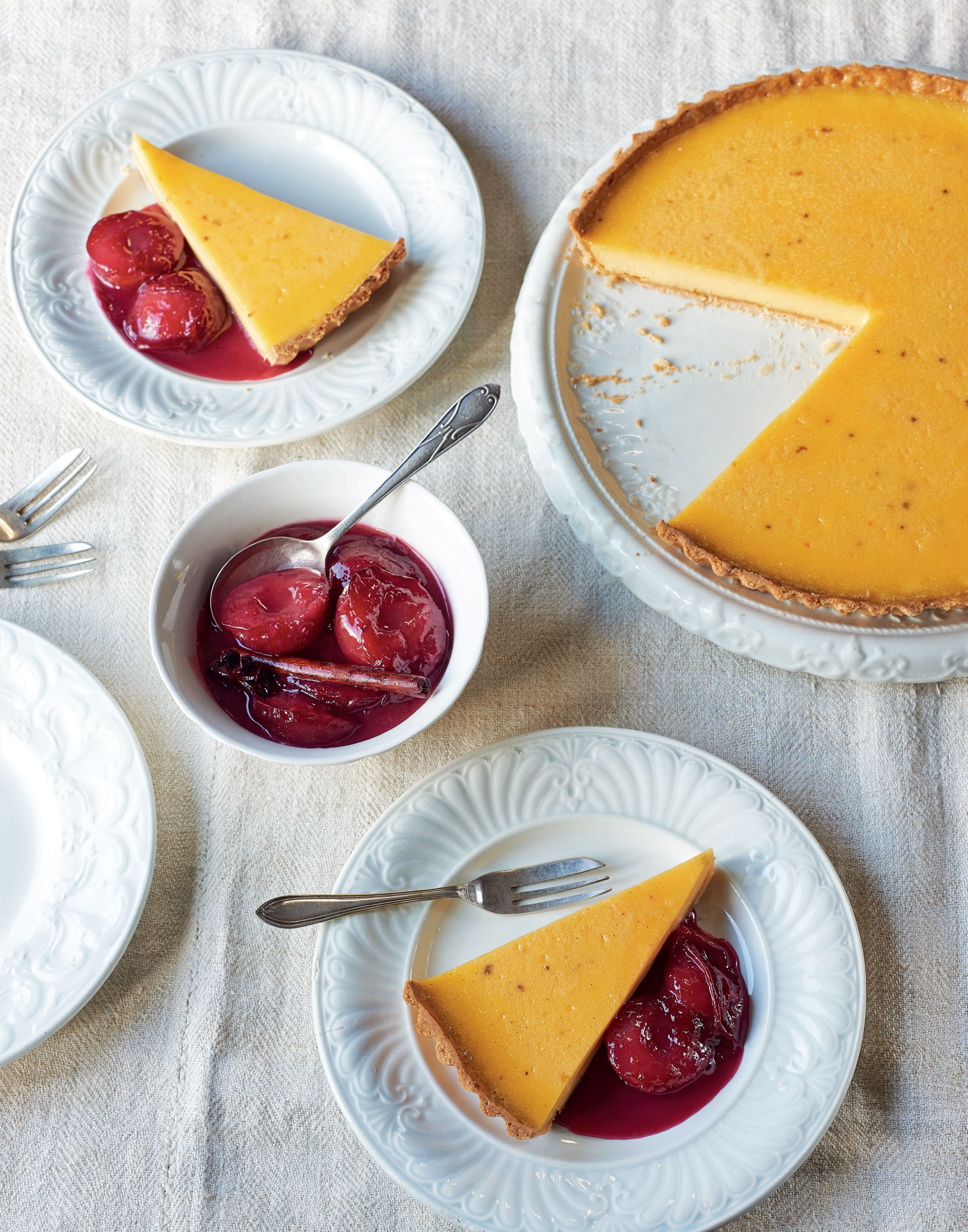 Baked custard tart with mulled spiced plums