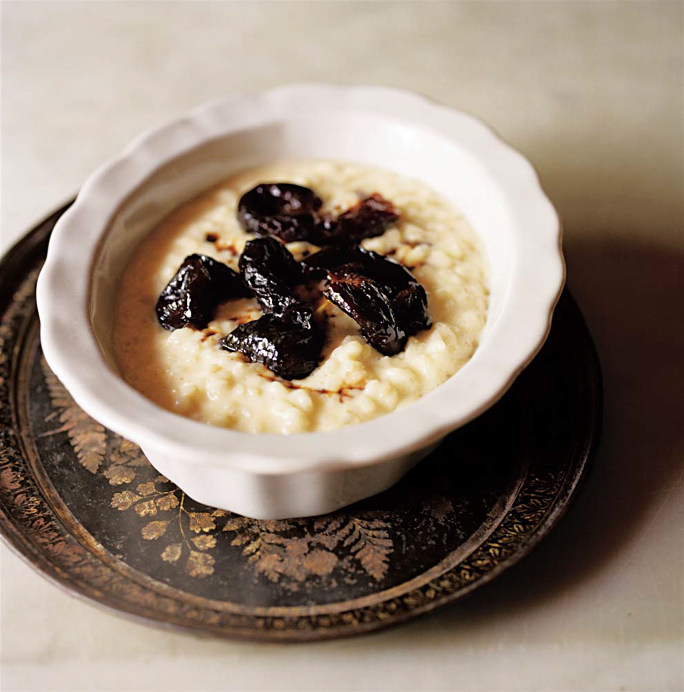 Rice pudding with poached prunes