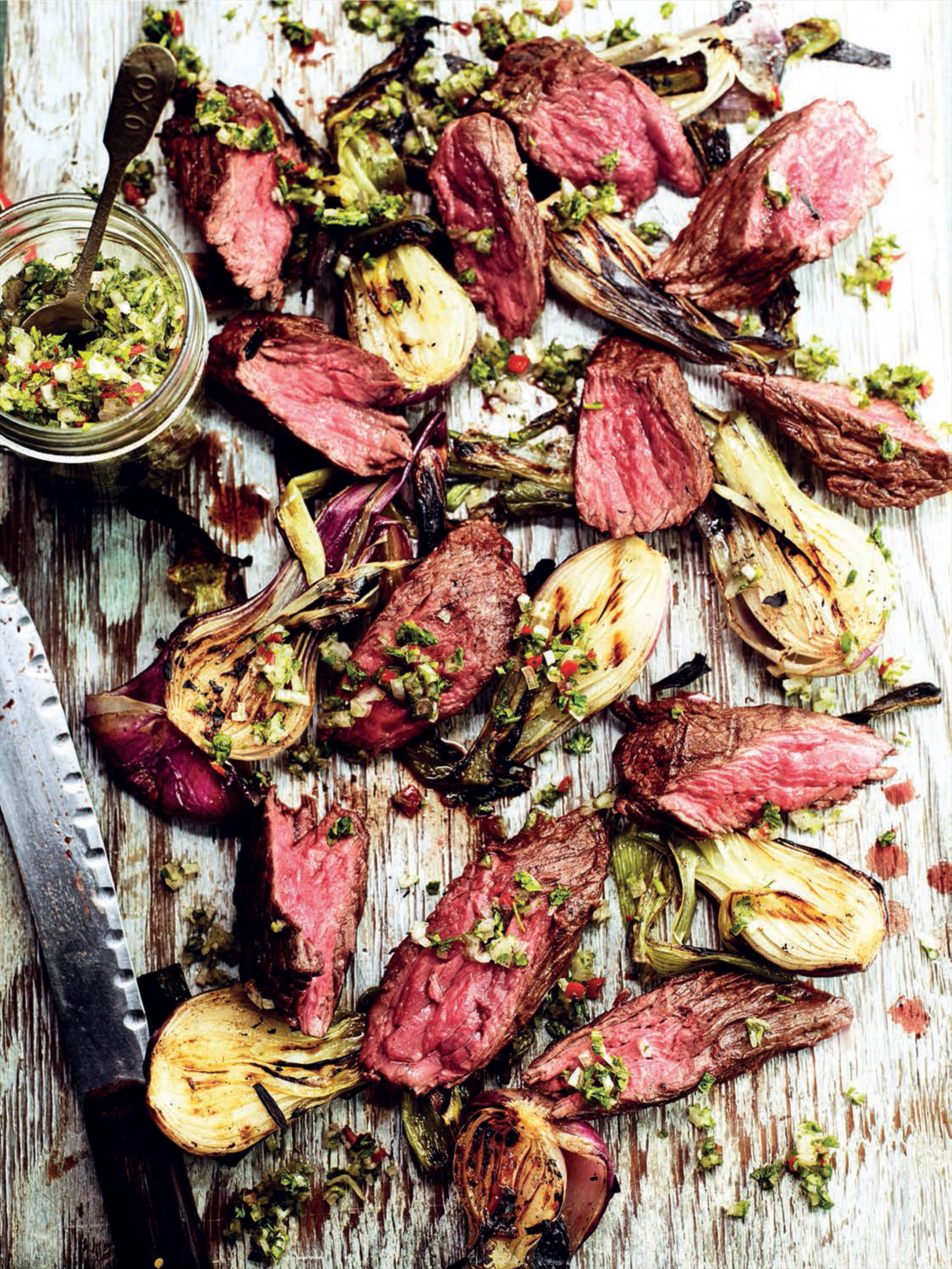 Marinated and grilled beef bavette with smoky salad onions