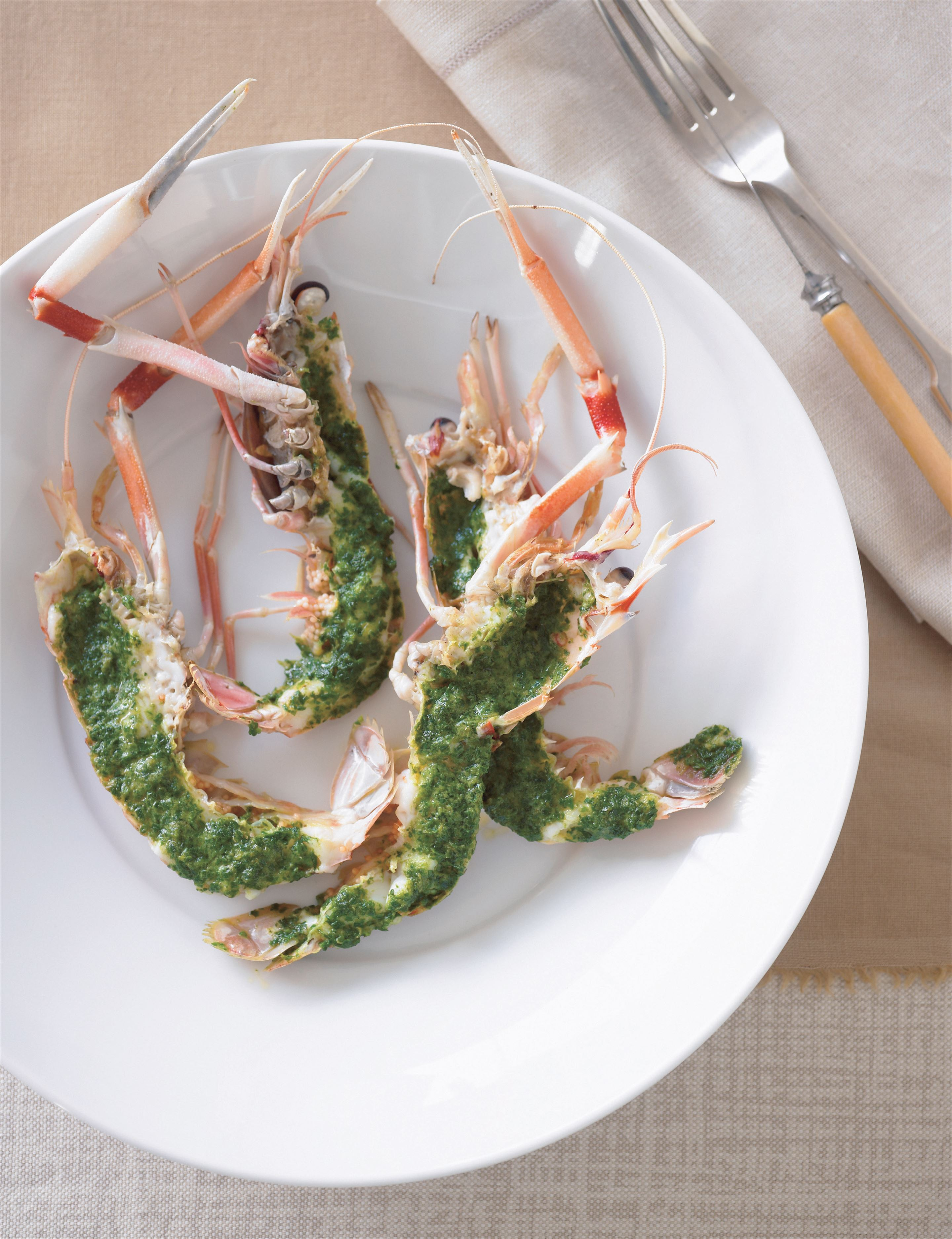Grilled scampi tails with lemon and parsley butter