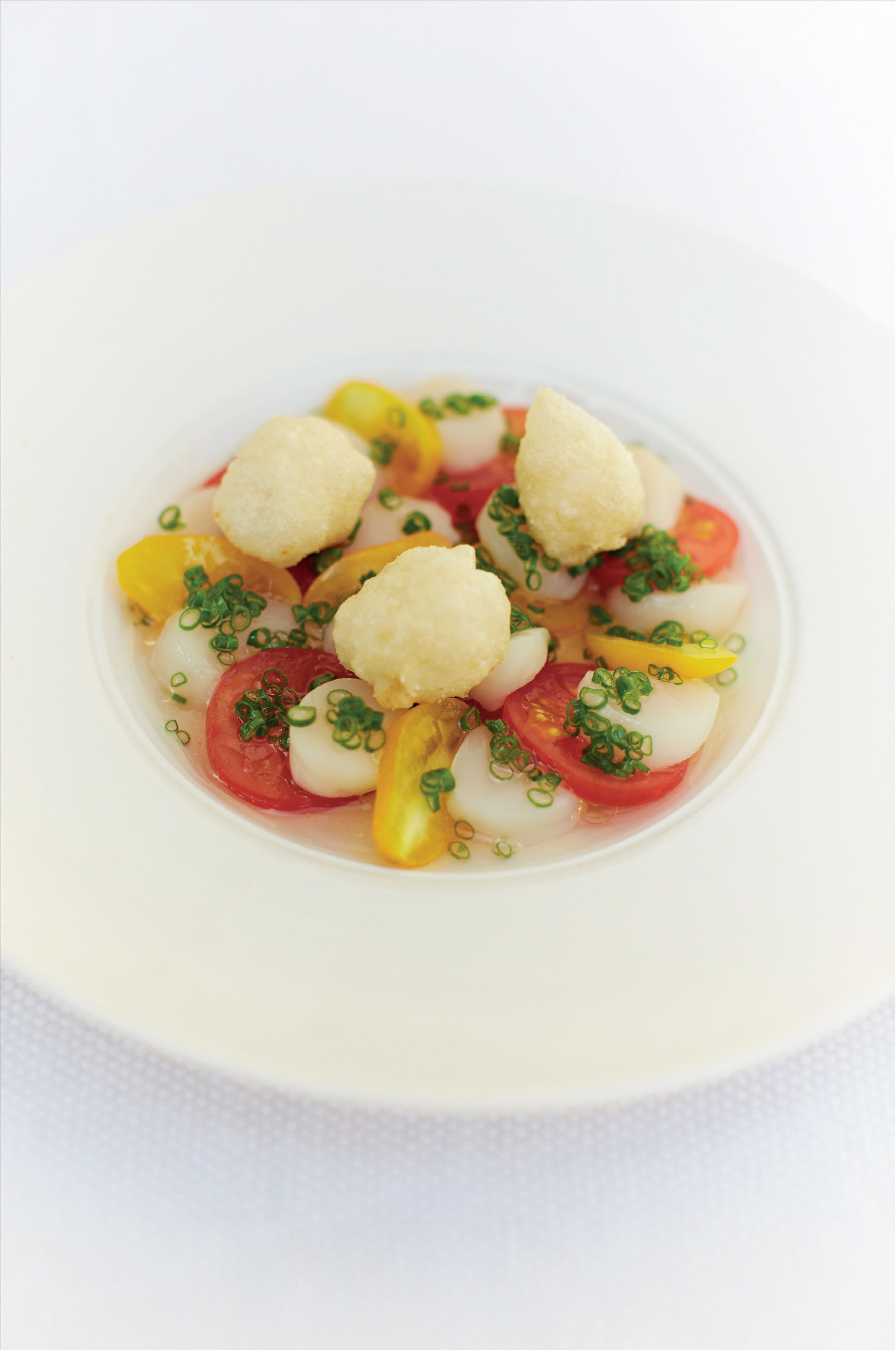 Raw queenie scallops, tomato water dressing and crisp-fried queenies