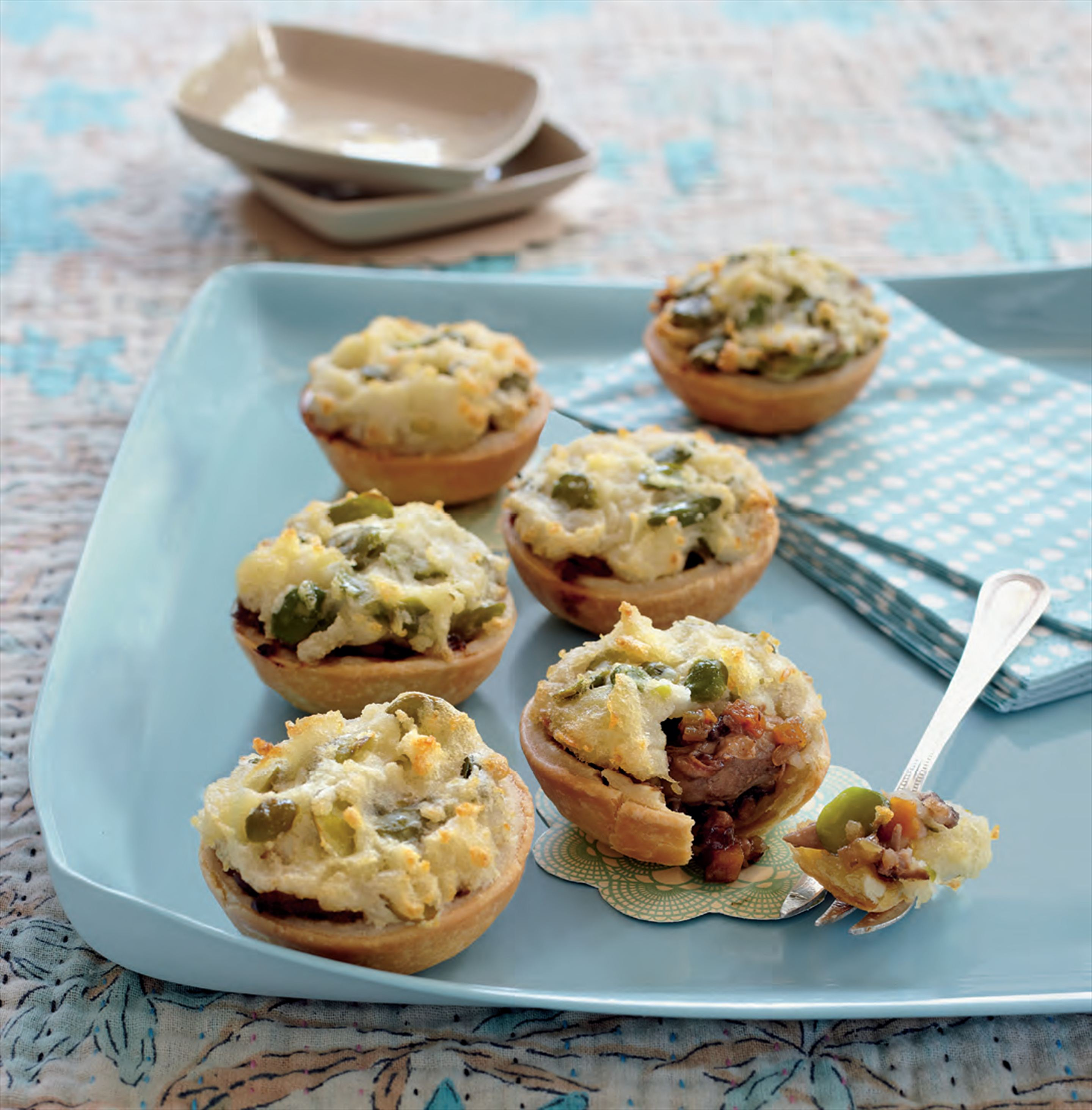 Mini duck pies with broad bean mash