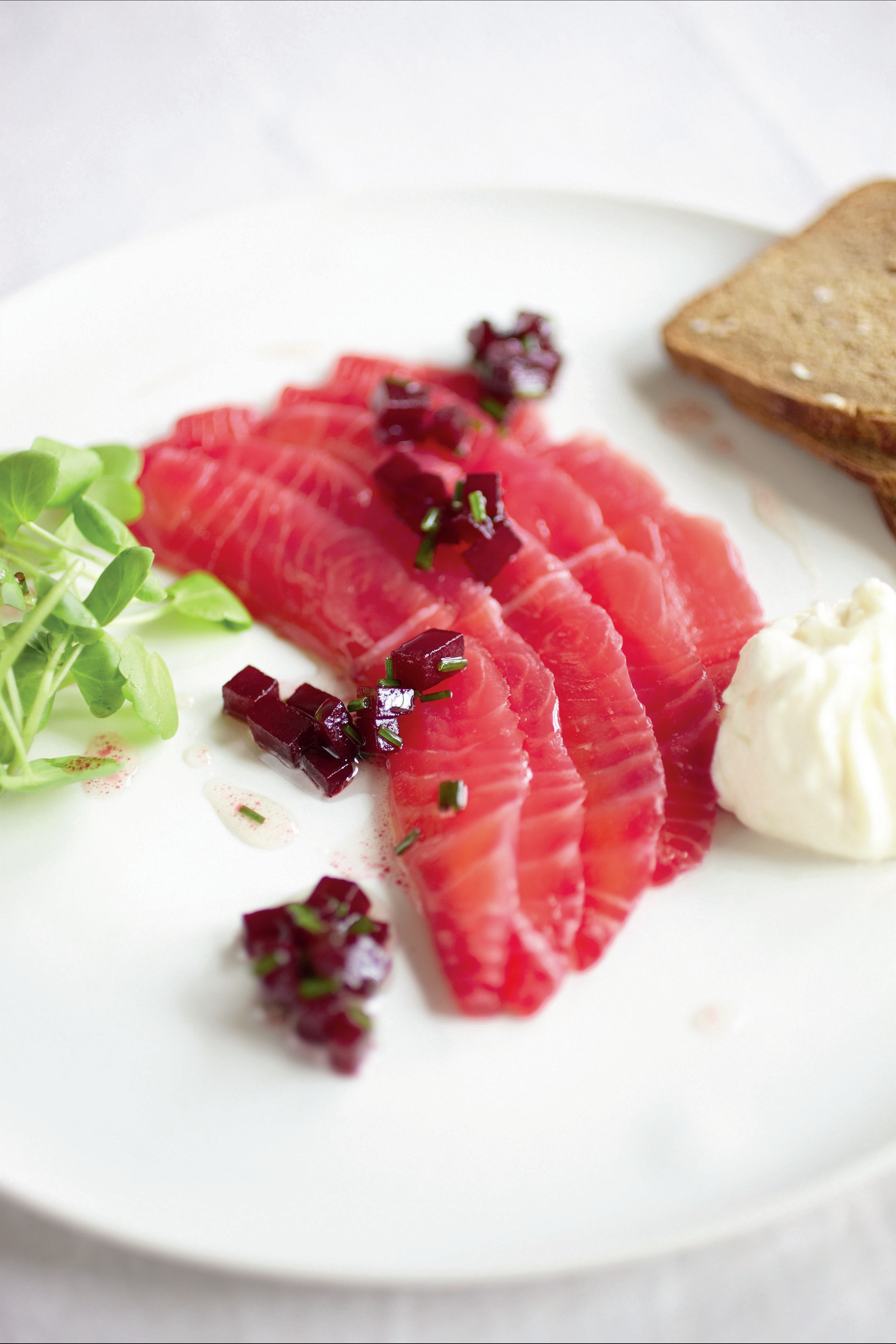 Cured salmon with beetroot dressing and horseradish cream