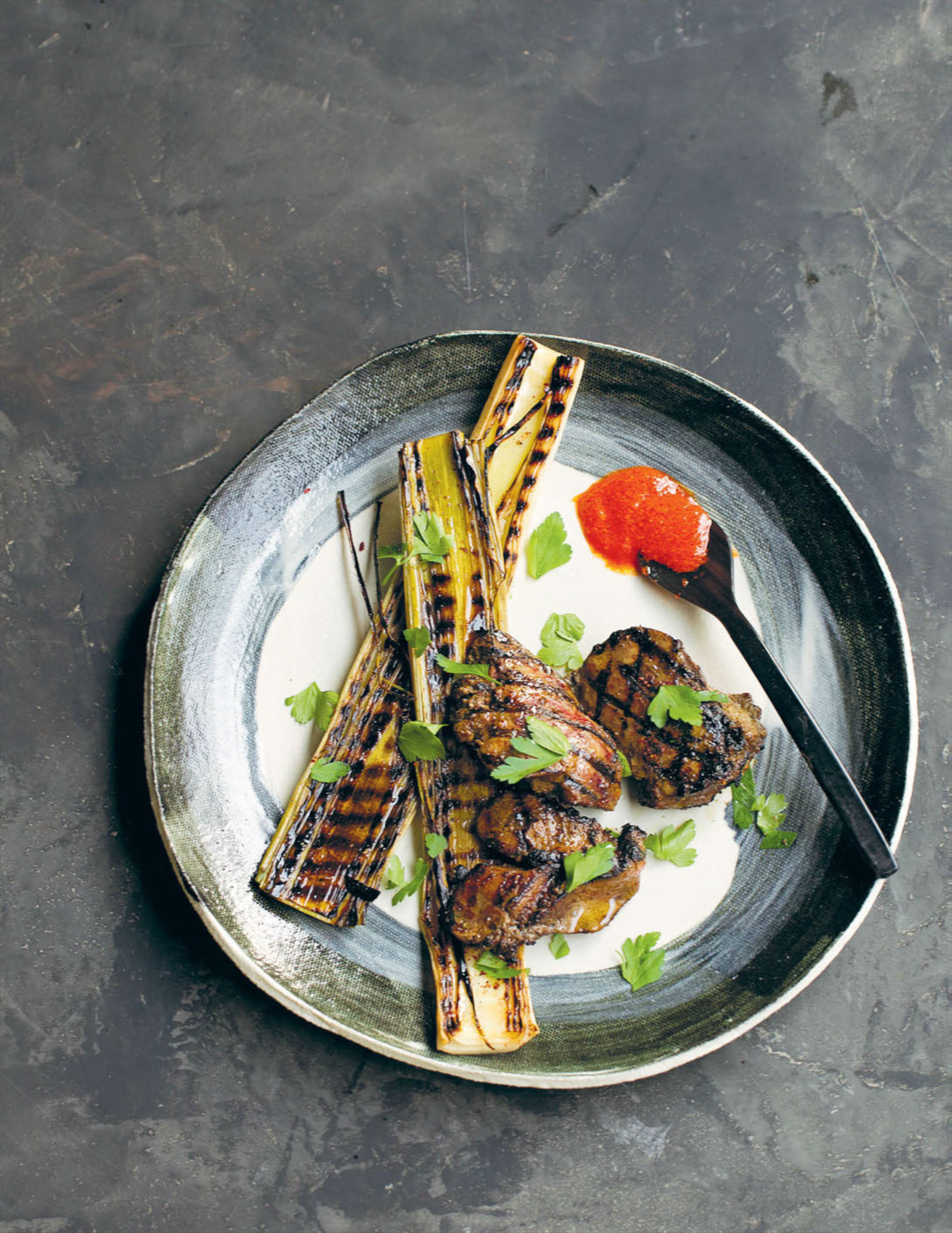 Grilled baby leeks, chicken livers and romesco sauce