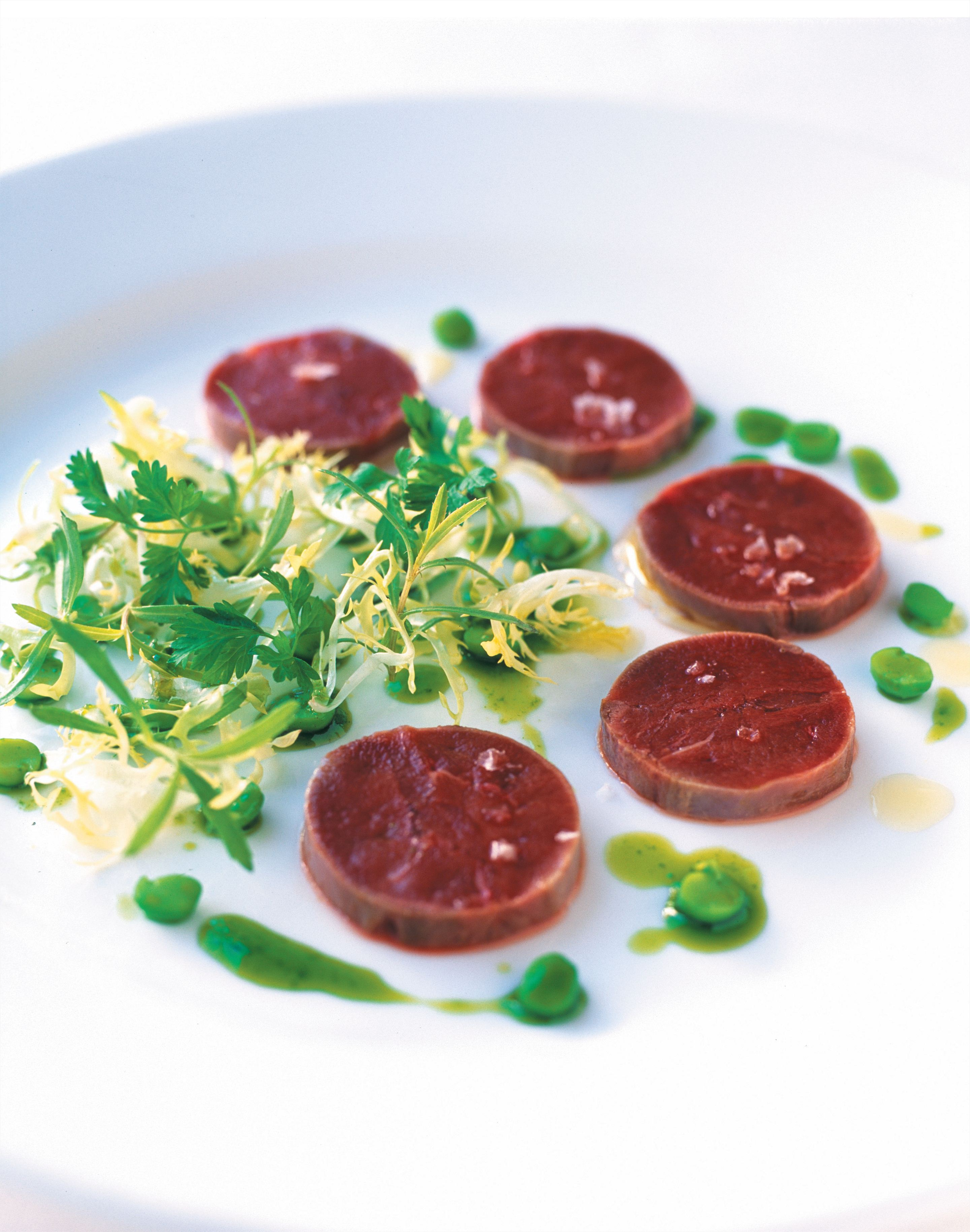 Carpaccio of squab with a herb salad and pea vinaigrette