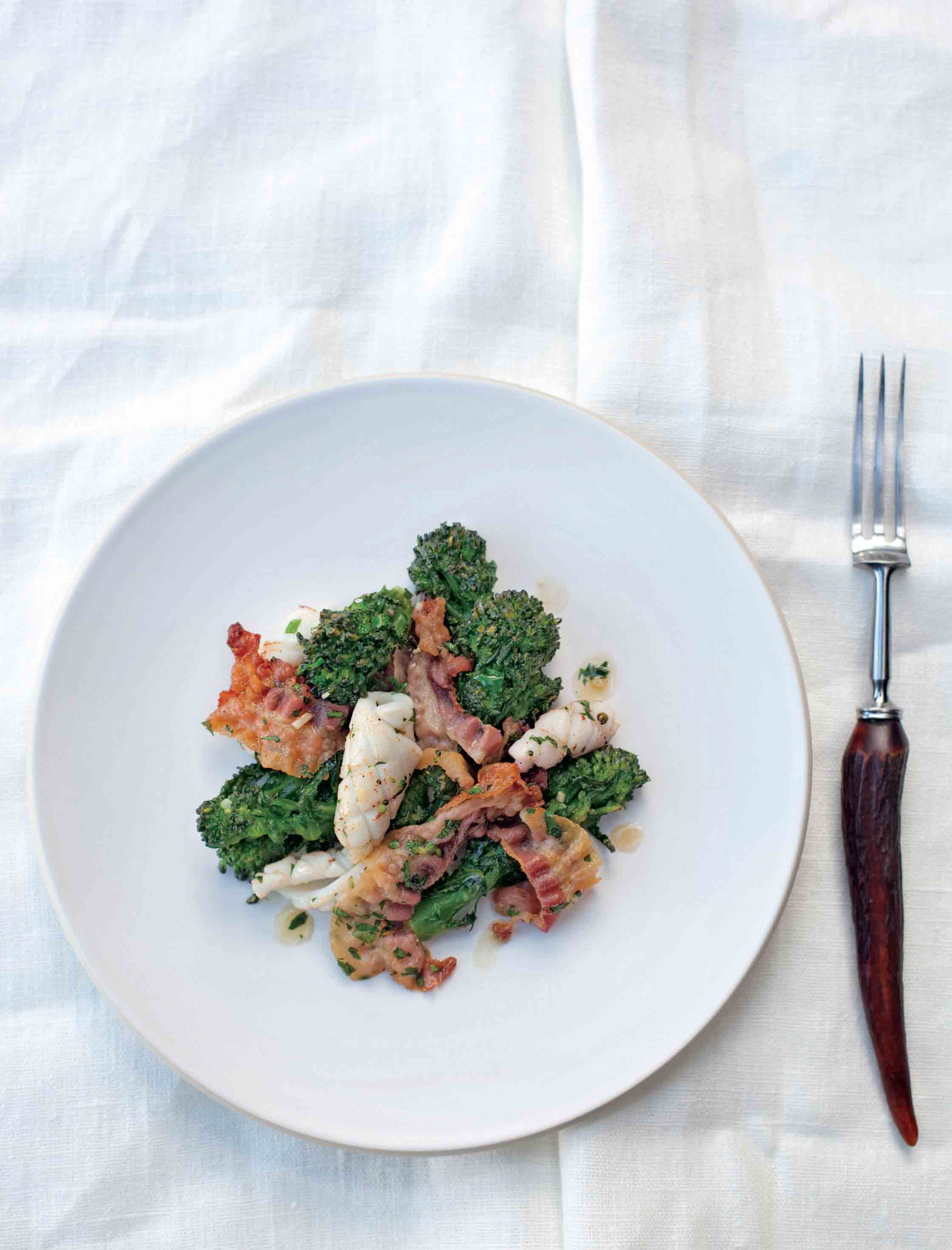 Sautéed purple sprouting broccoli with pancetta and squid