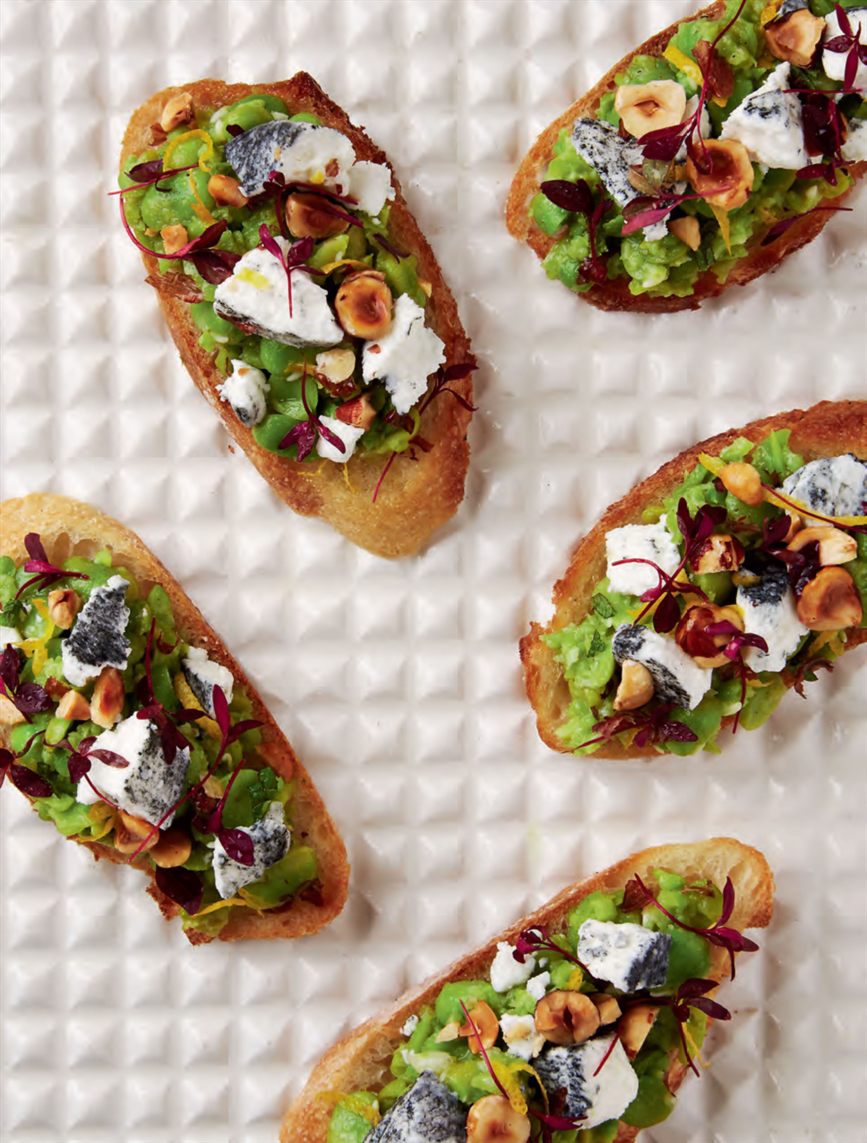 Broad bean, mint & goat's cheese crostini