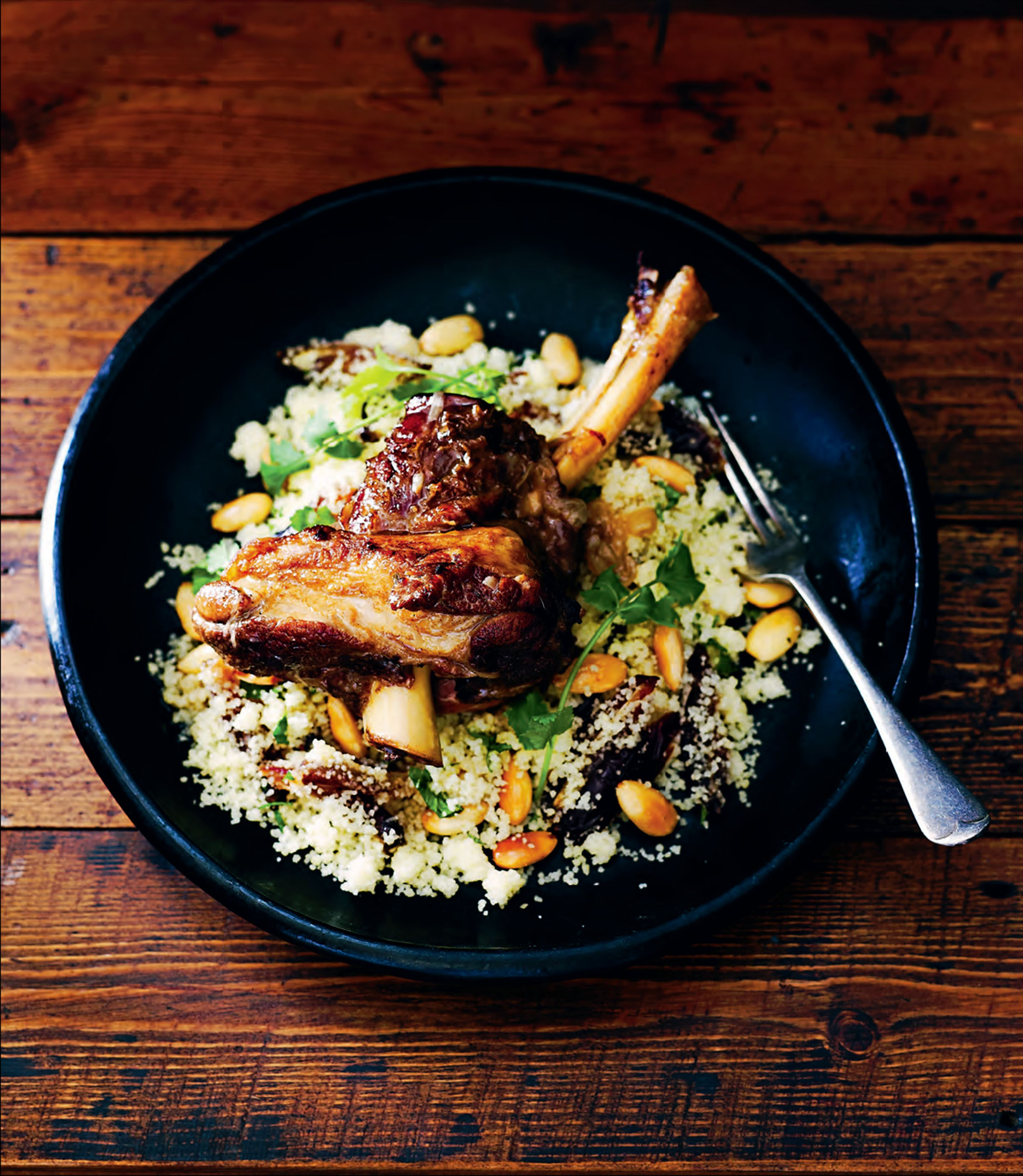 Moroccan spiced lamb shanks with date and roasted almond couscous