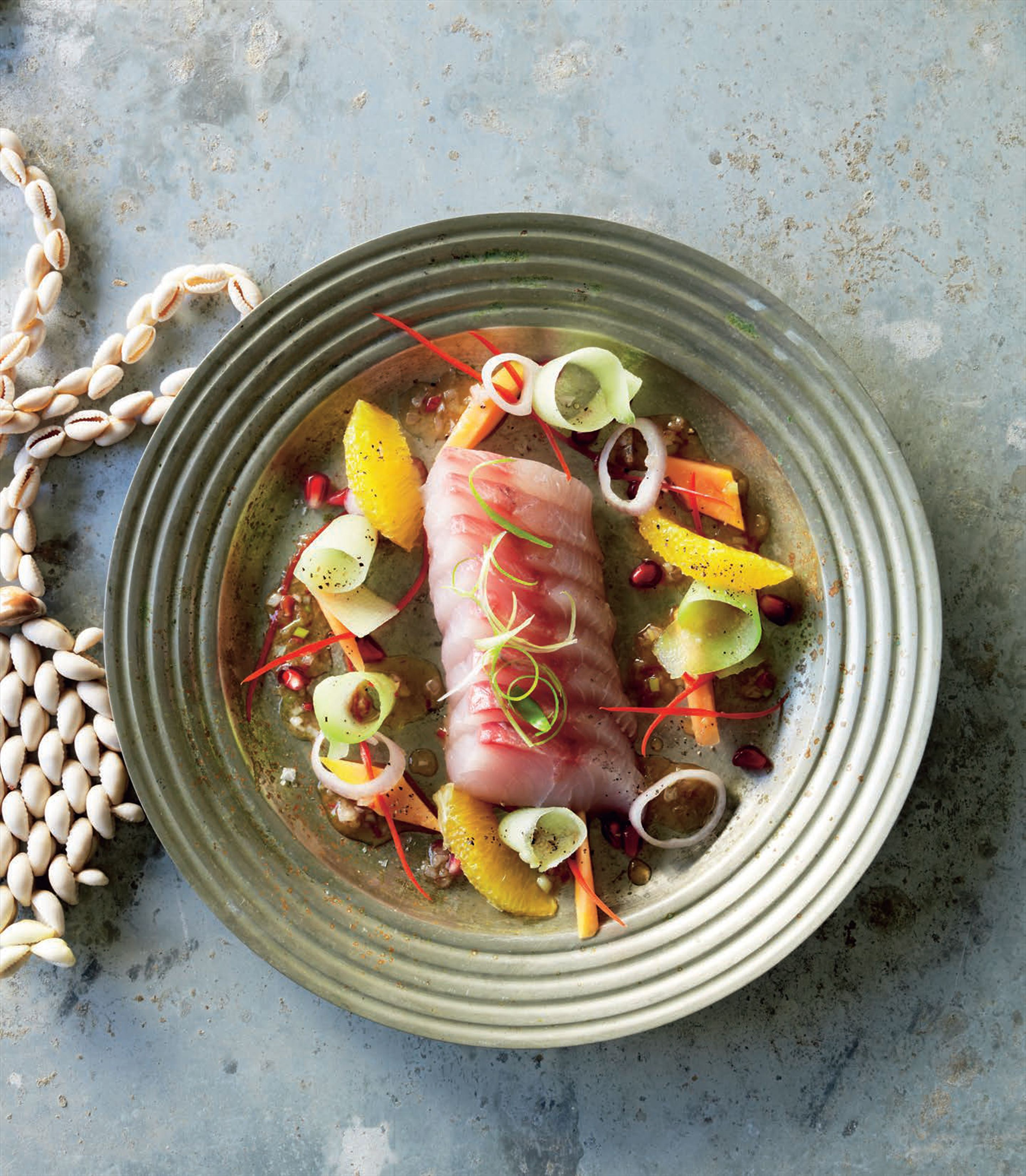 Raw trevally salad with pomegranate